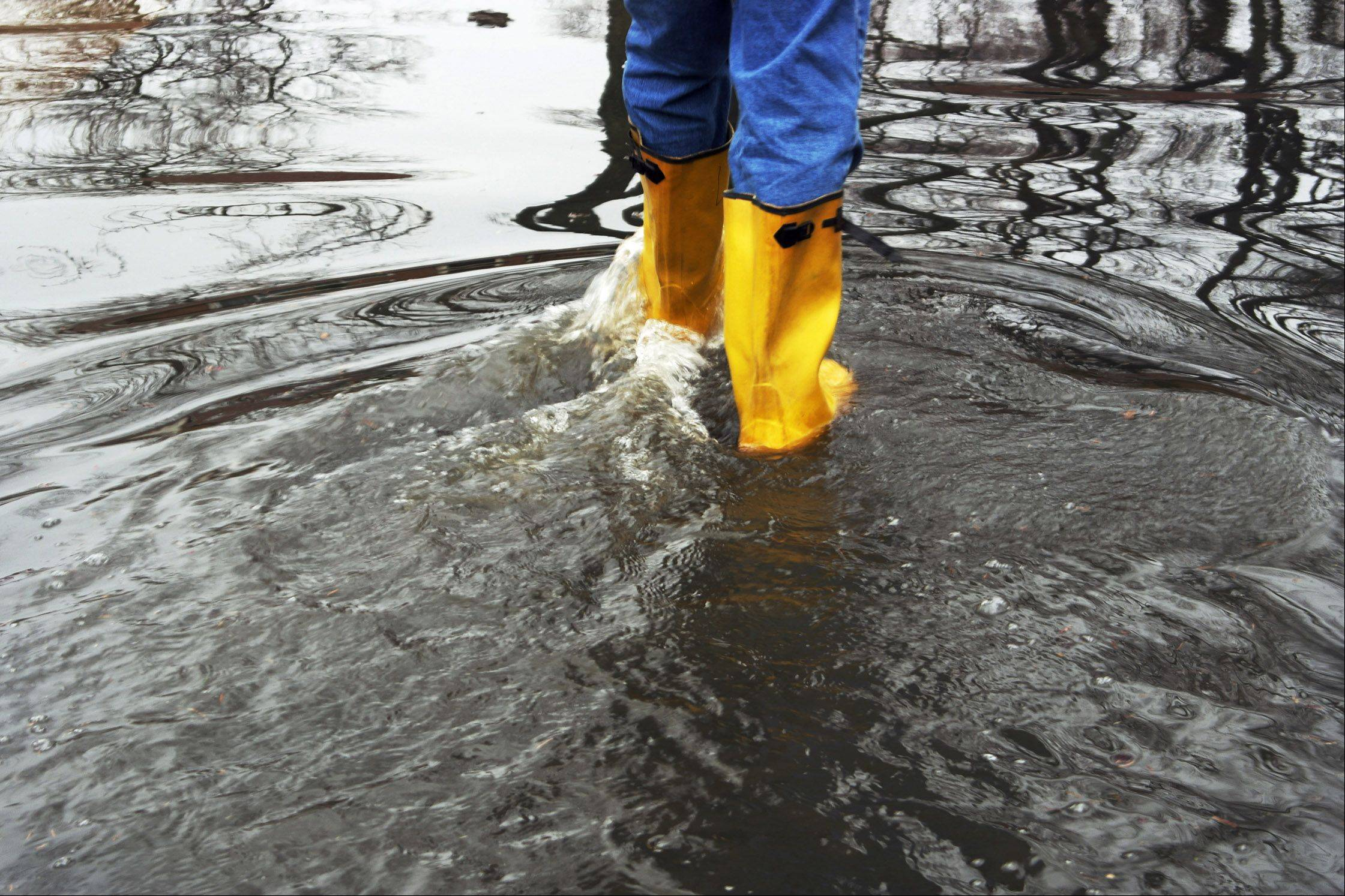 A man walks through the floodwaters on Patricia Lane in Prospect Heights on April 18th.