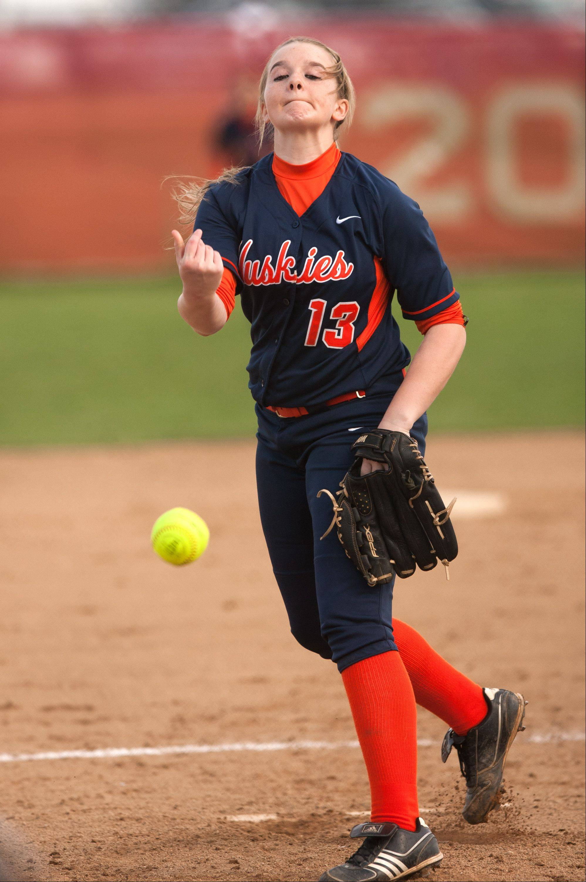Daniel White/dwhite@dailyherald.comNaperville North pitcher Casey Rechenmacher delivers a pitch against Naperville Central, during girls softball action.