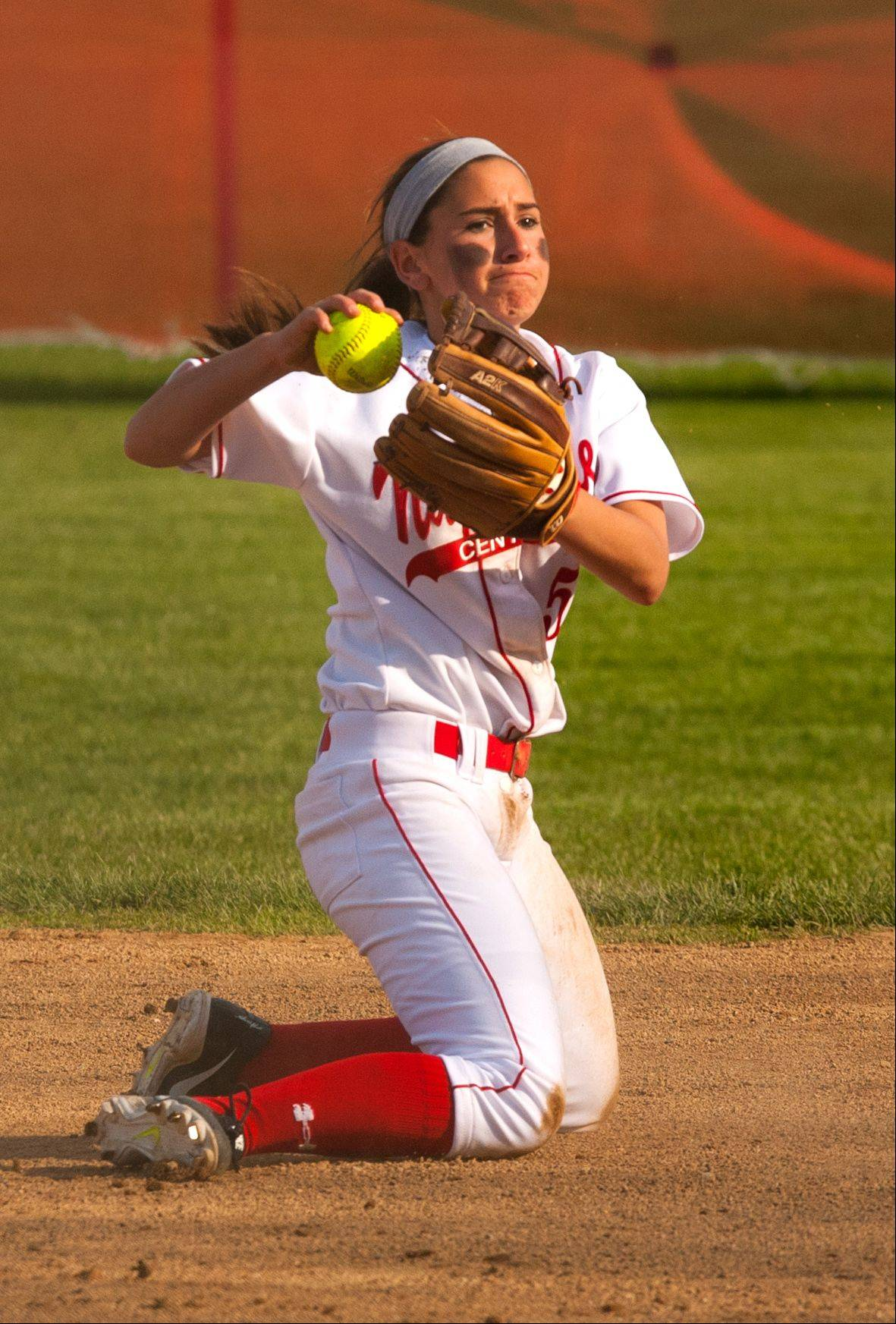 Daniel White/dwhite@dailyherald.comNaperville Central's Lindsey Gonzalez throws out a Naperville North batter, during girls softball action.