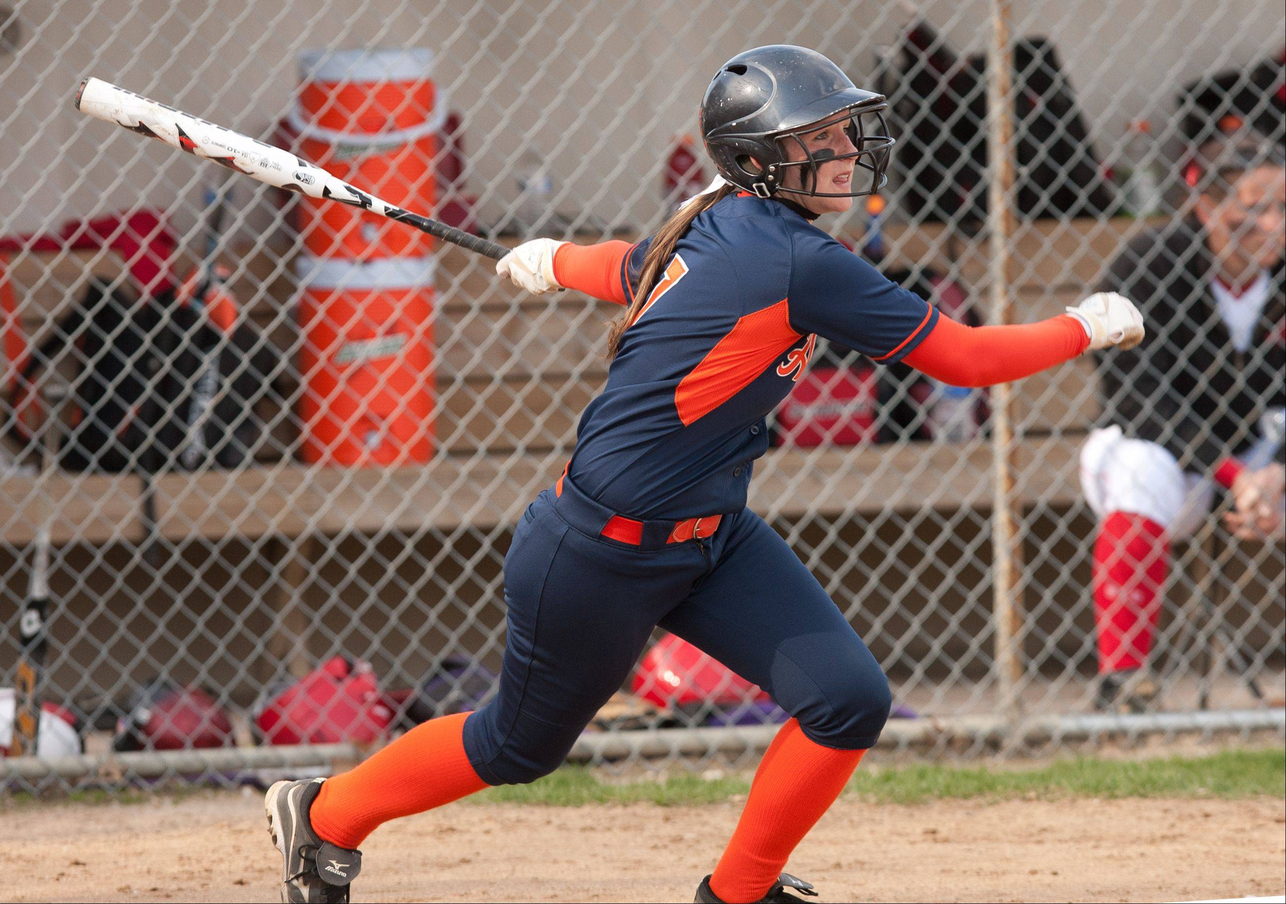 Daniel White/dwhite@dailyherald.comNaperville North's Alexis Solak doubles in two runs in the top of the second inning against Naperville Central, during girls softball action.