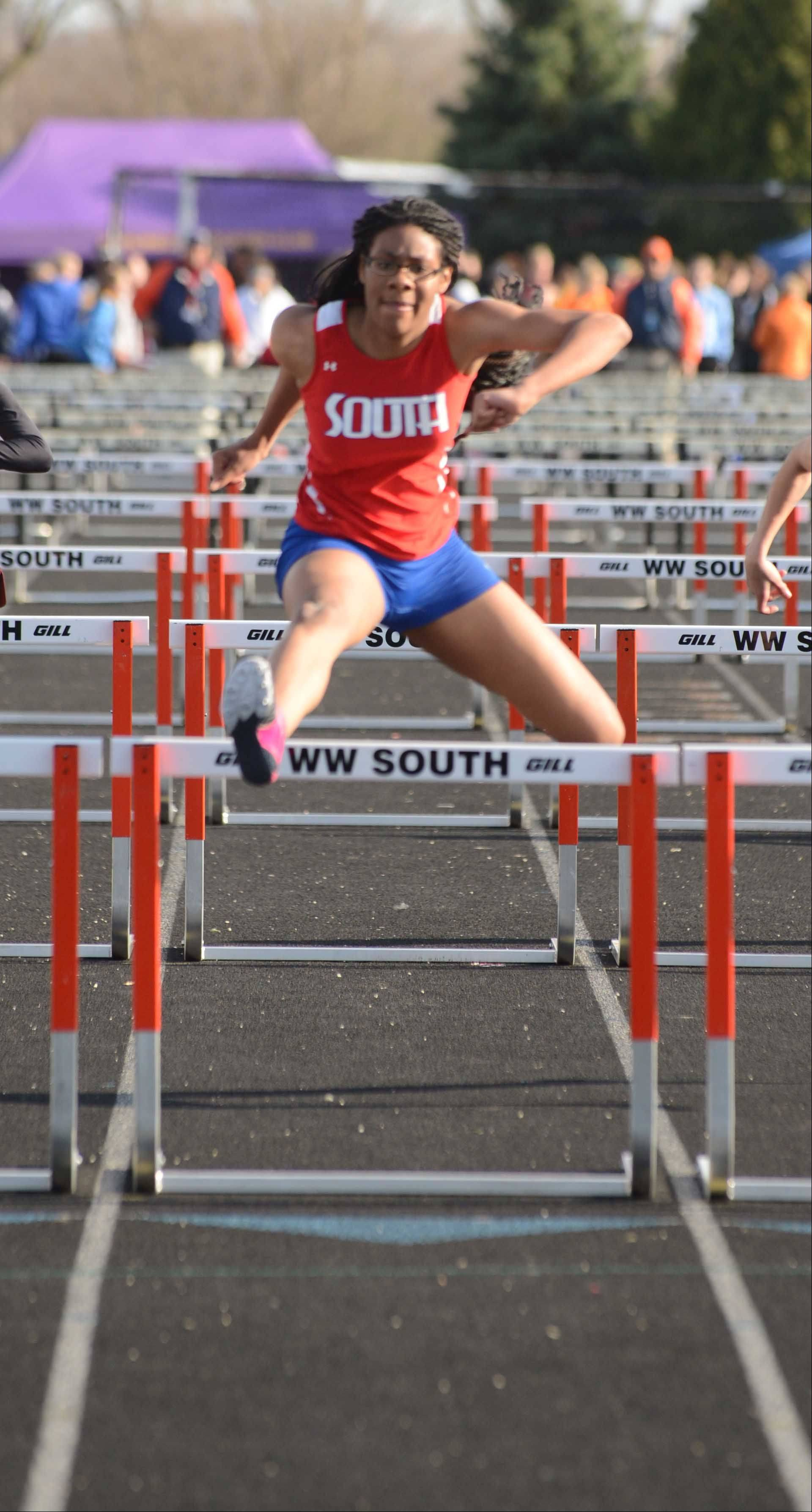 Katelyn Hill of Glenbard south runs the 100meter hurdles during the Wheaton Warrenville South girls track meet Friday.