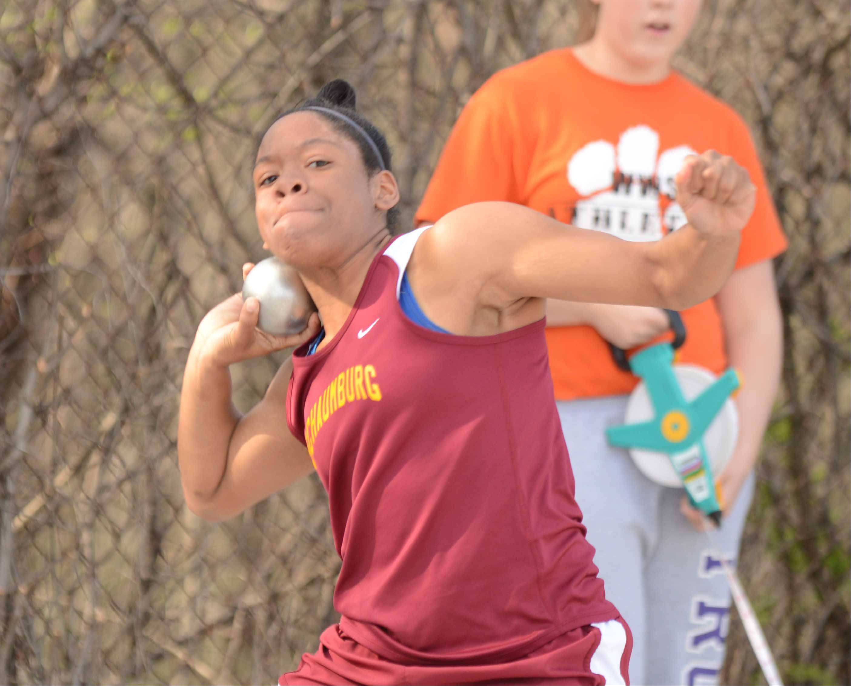 Jasmine Bethea of Schaumburg tosses the shot put during the Wheaton Warrenville South girls track meet Friday.