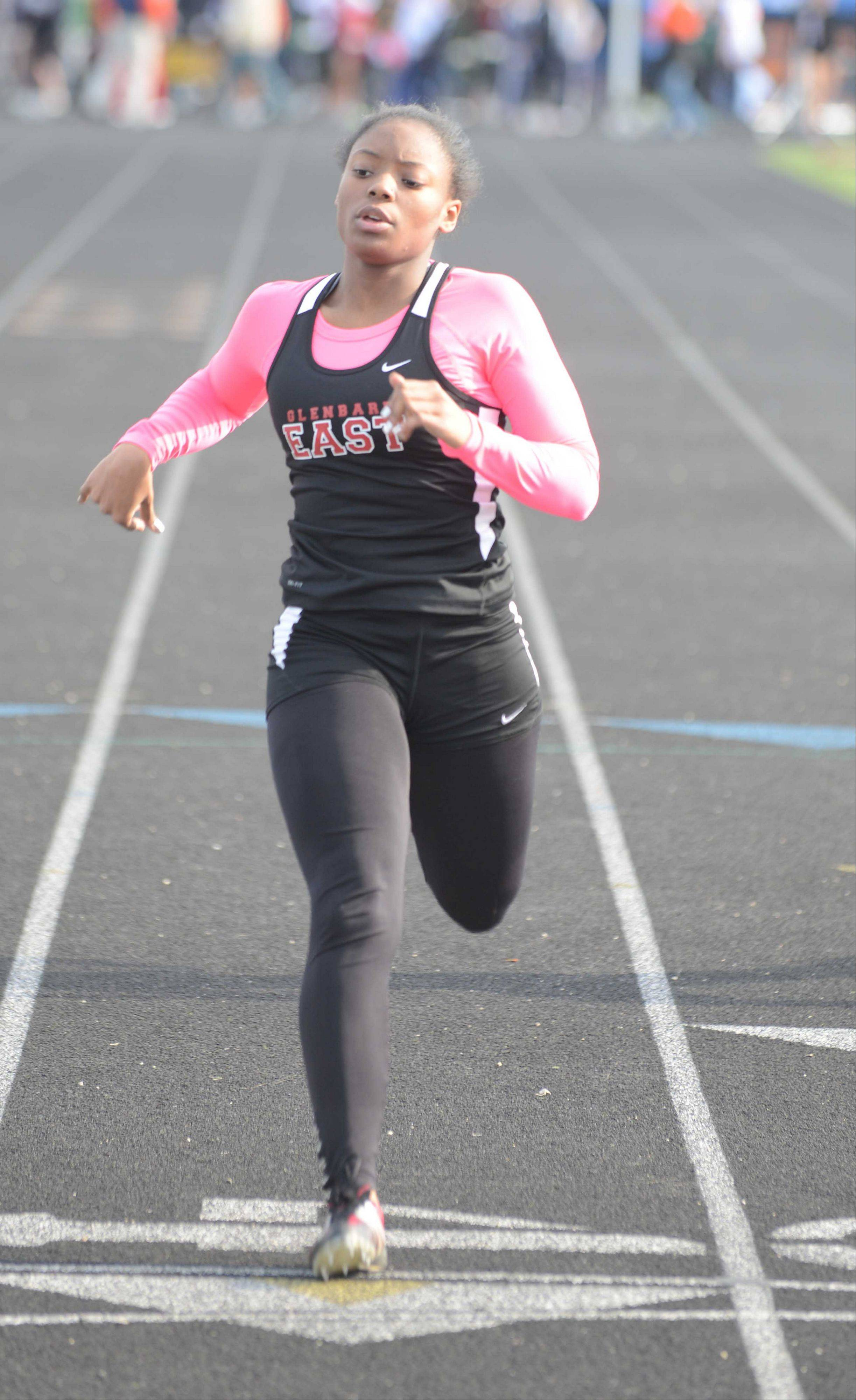 Darian Wellington of Glenbard East takes part in the 100 meter dash during the Wheaton Warrenville South girls track meet Friday.