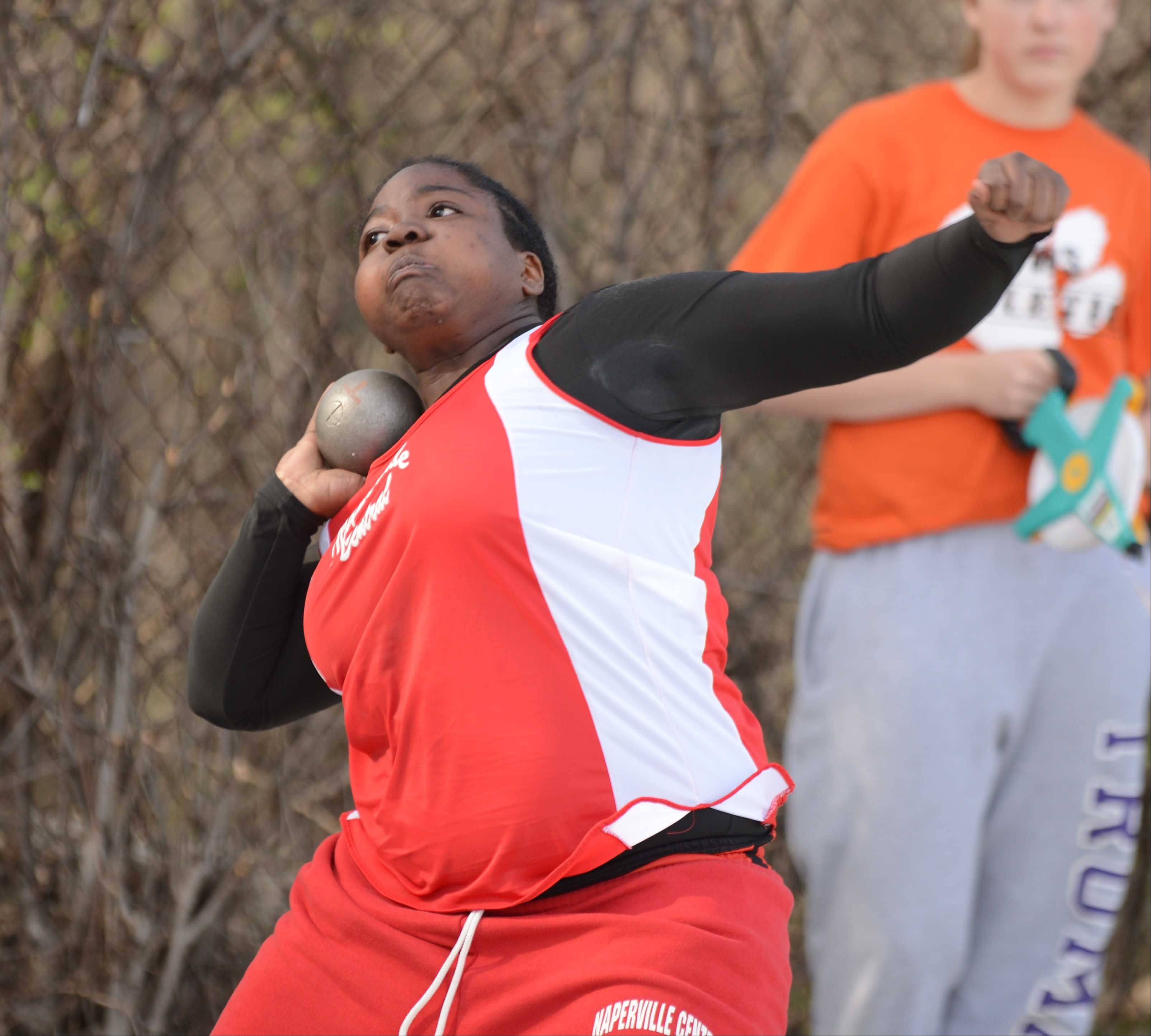Tina Norris of Naperville Central throws the shot put during the Wheaton Warrenville South girls track meet Friday.