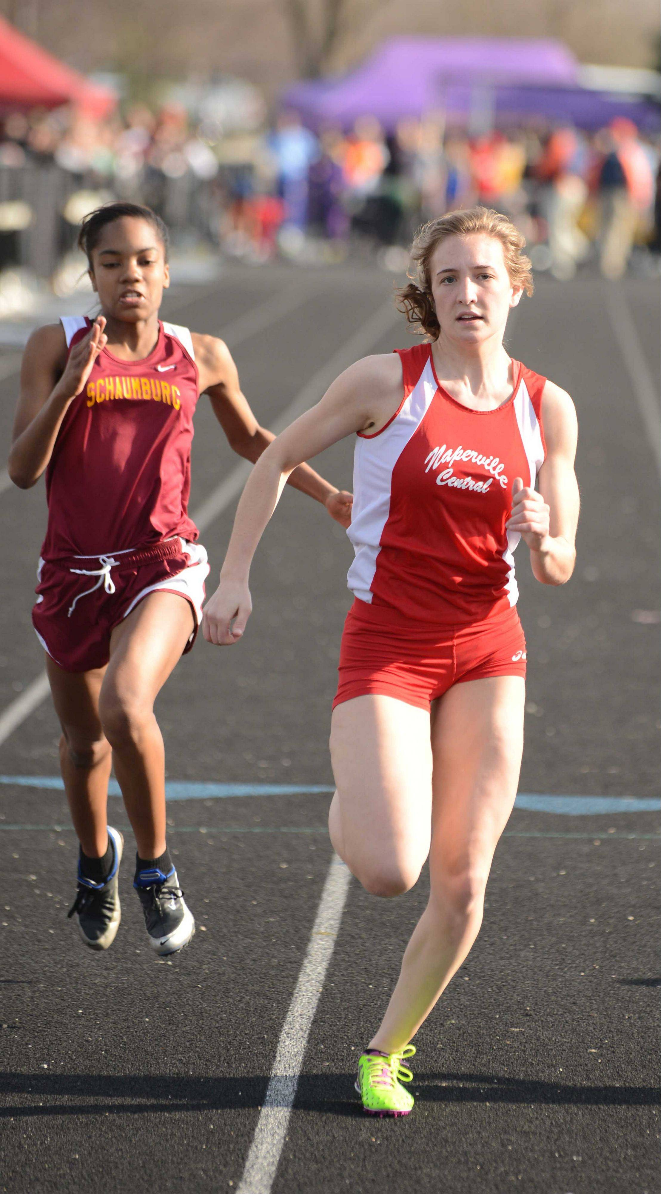 Lauren Erickson of Naperville Central runs the 100 meter dash during the Wheaton Warrenville South girls track meet Friday.