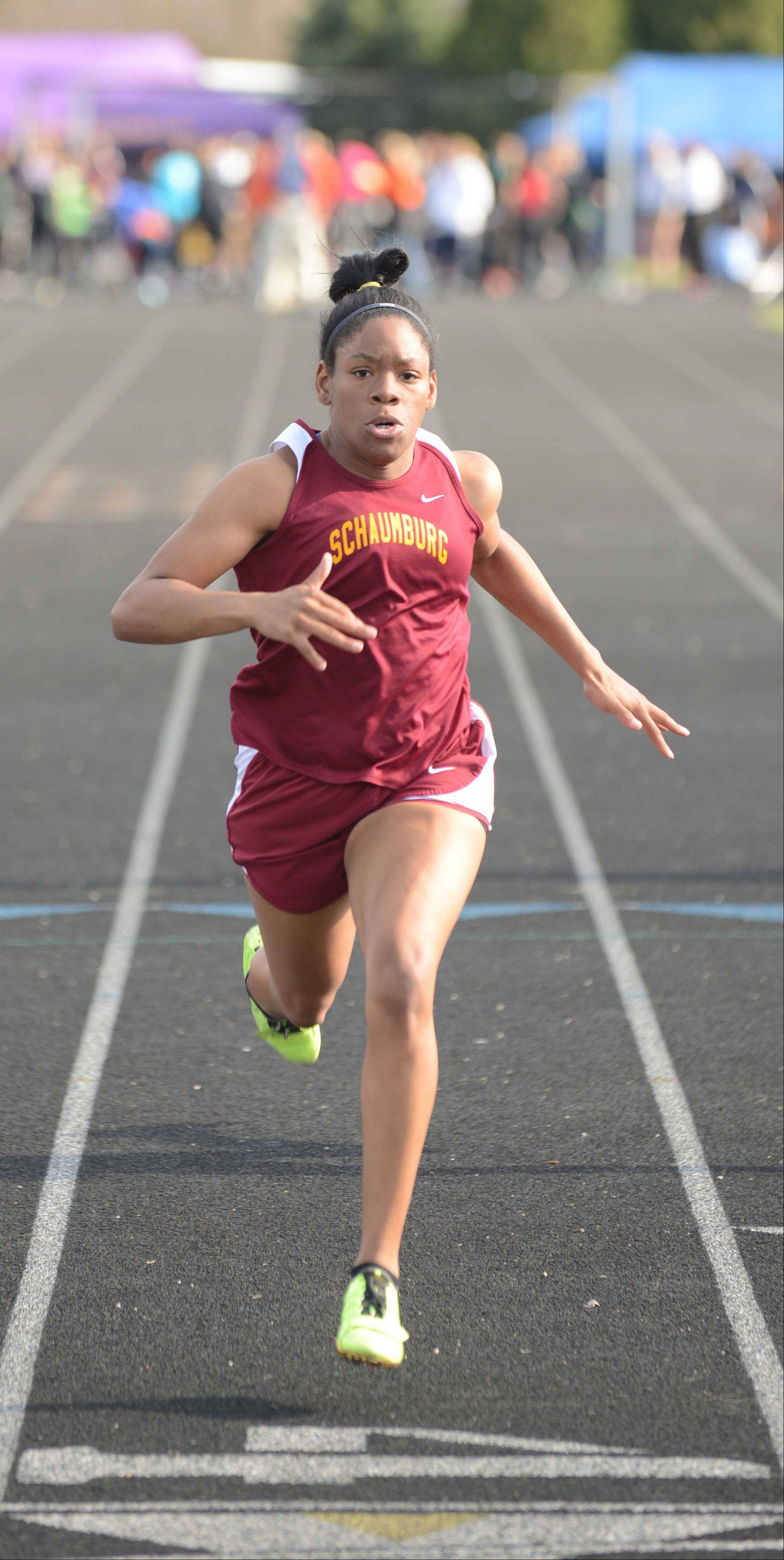 Jasmine Bethea of Schaumburg races the 100 meter dash during the Wheaton Warrenville South girls track meet Friday.