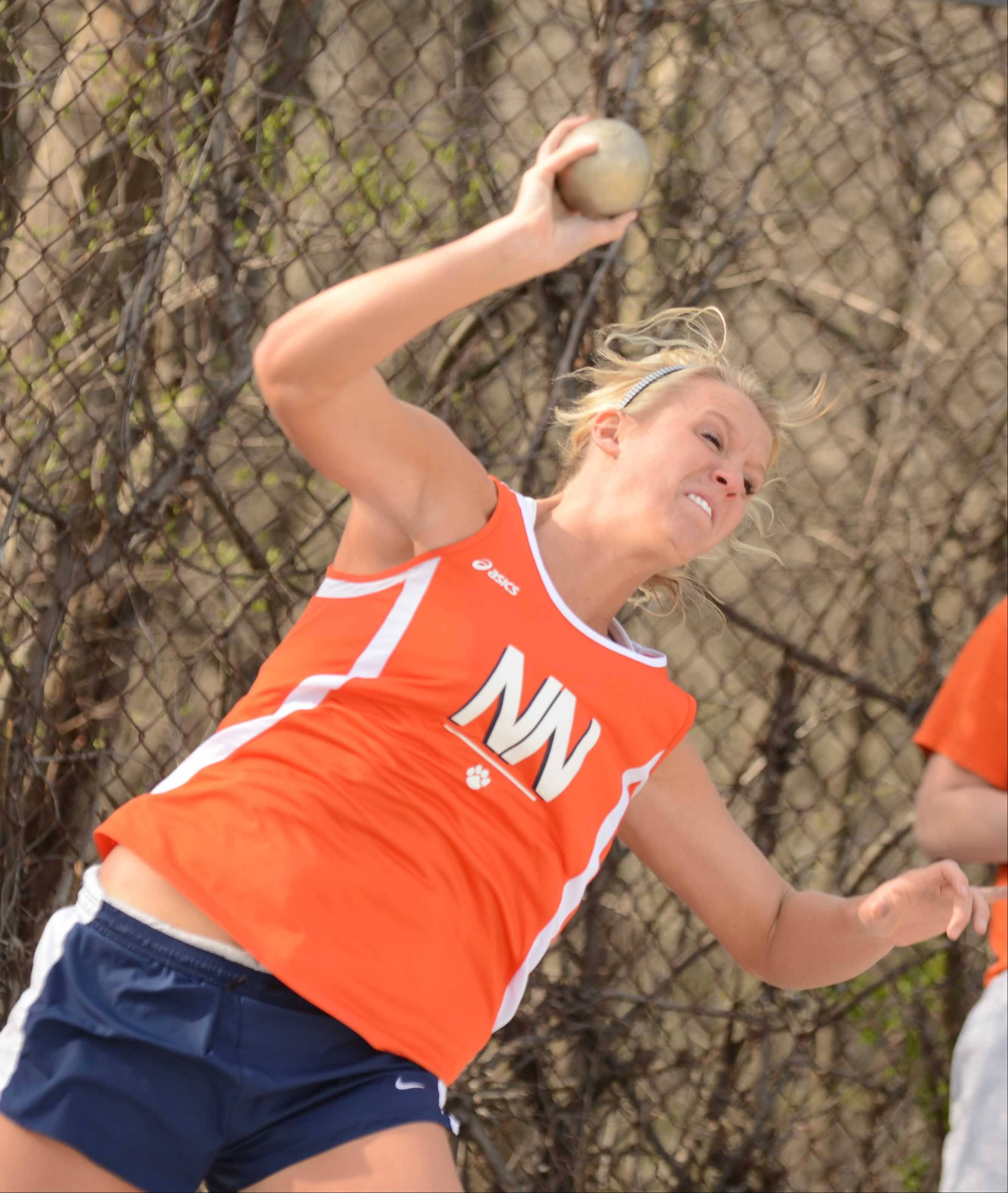 Sydnee Reinhard of Naperville North throws the shot put during the Wheaton Warrenville South girls track meet Friday.