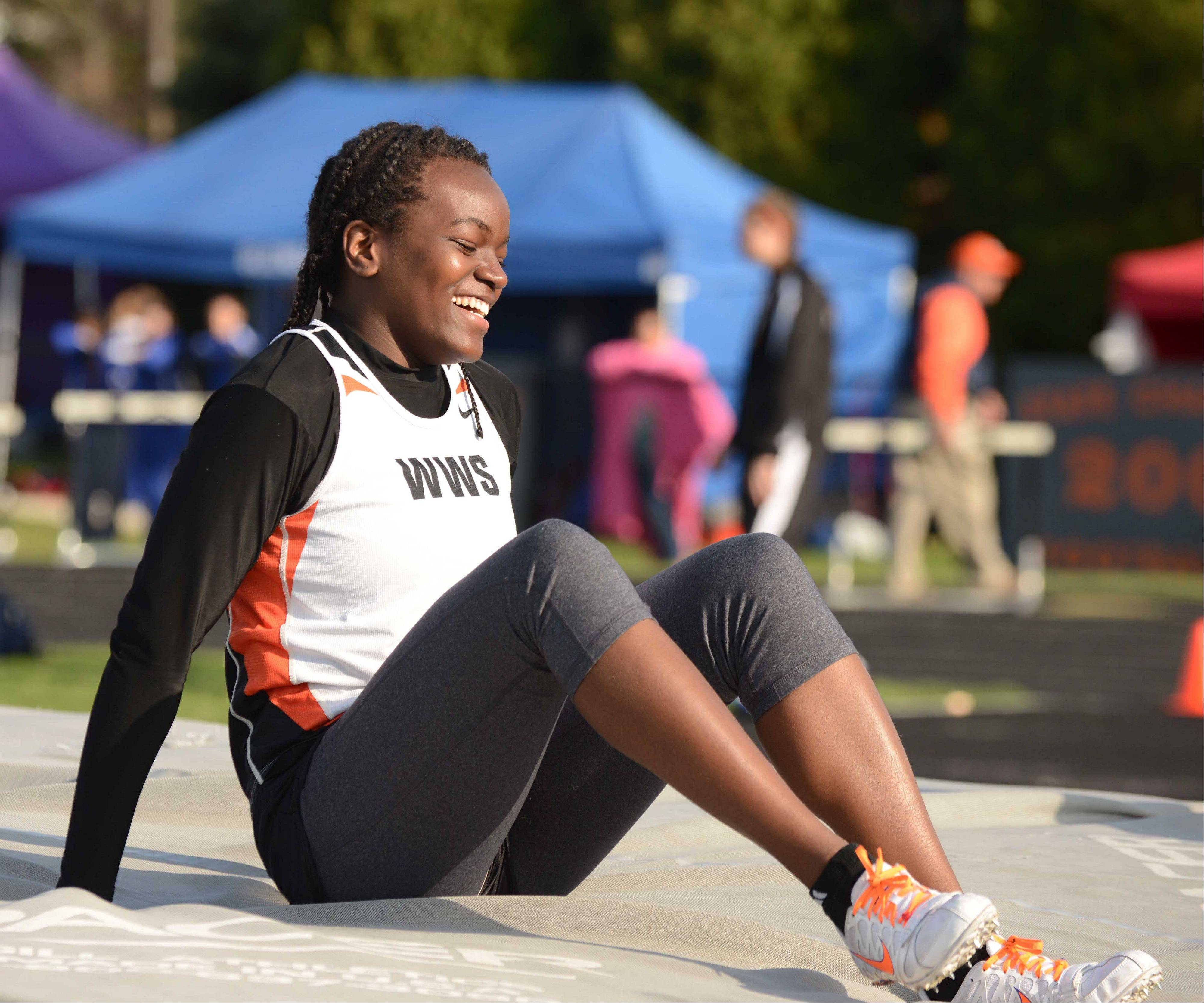 Teso Coker of Wheaton Warrenville South is all smiles after clearing the bar at 5.1 during the Wheaton Warrenville South girls track meet Friday.