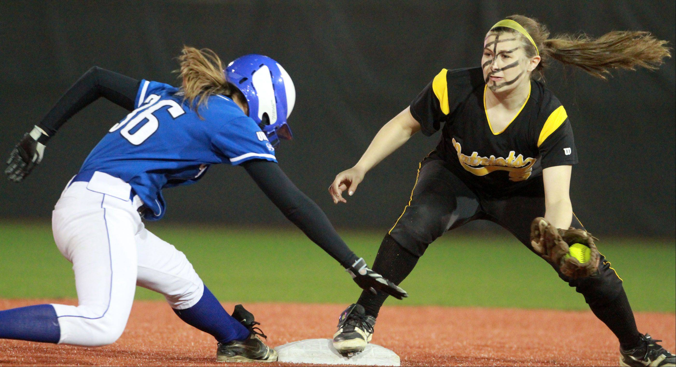 Vernon Hills' Nikki Goldstein reaches back after overrunning second base as Stevenson shortstop Taylor Koenigs reaches for the tag at The Ballpark at Rosemont on Friday.