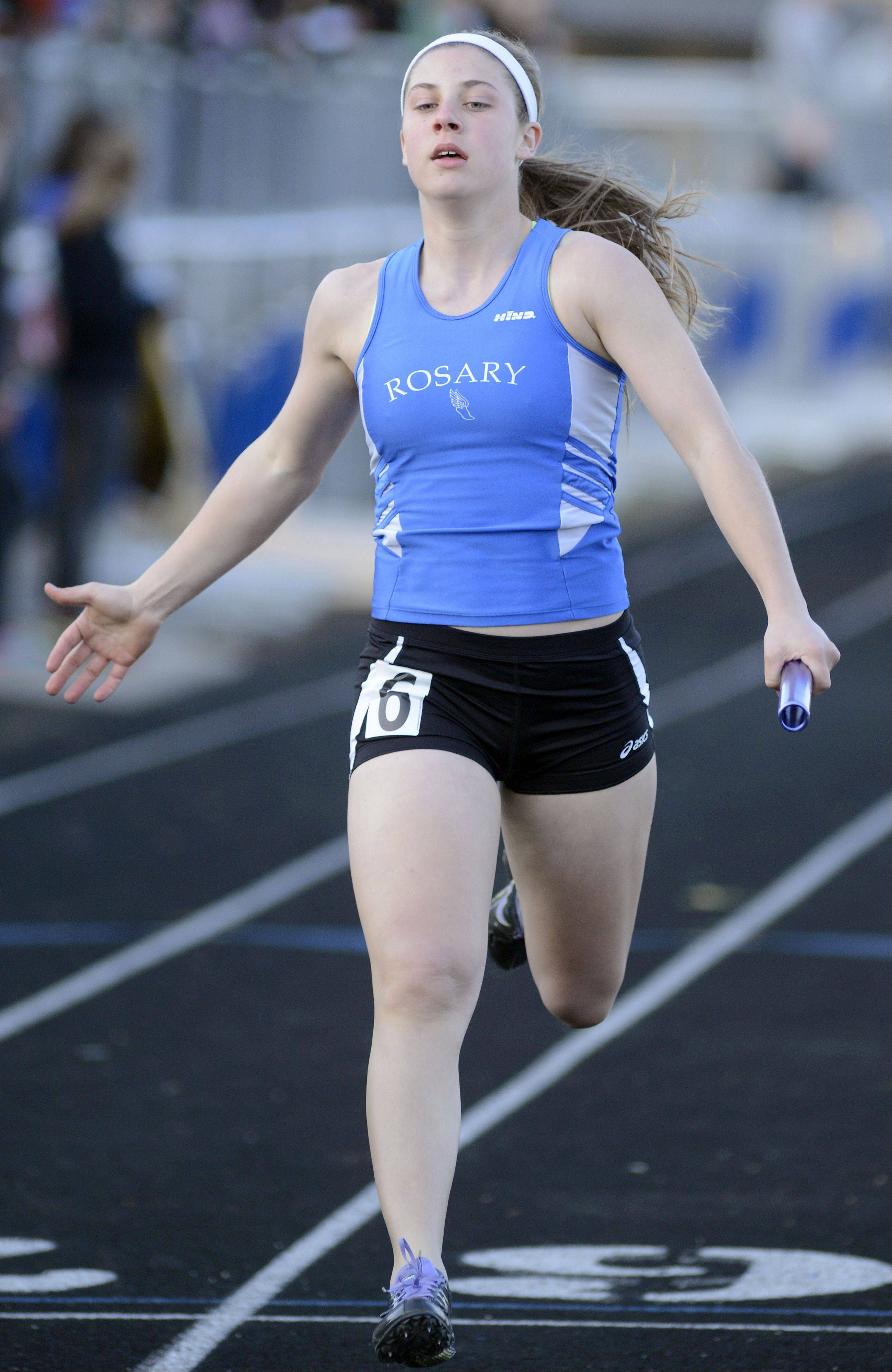 Rosary's Megan Conlin seals the deal for the Royals taking first place in the final heat of the 4 x 200 meter relay at the Kane County Invitational track in Geneva meet on Friday, April 26.