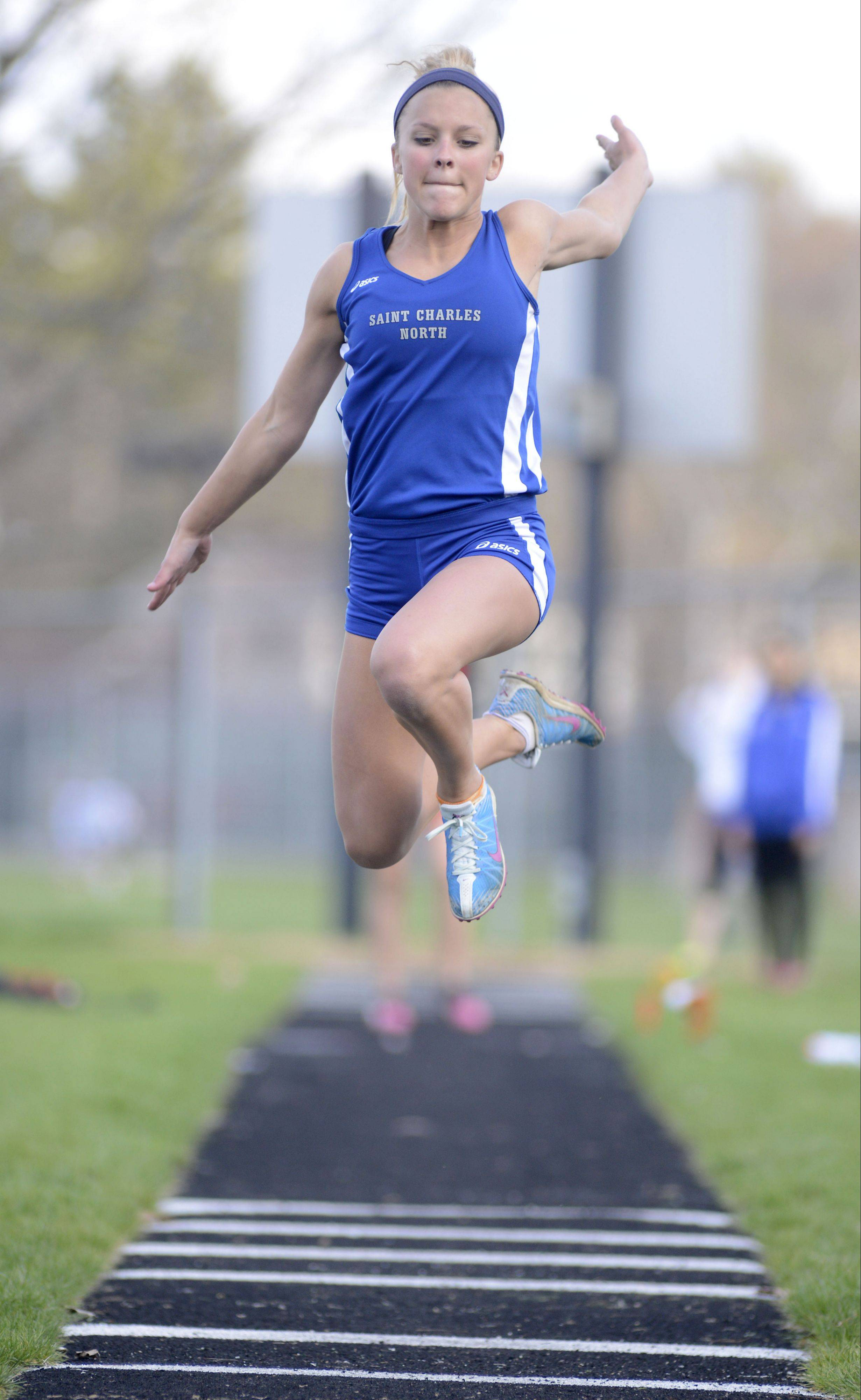 St. Charles North's Hannah Schlib competes in the long jump at the Kane County meet Friday in Geneva.