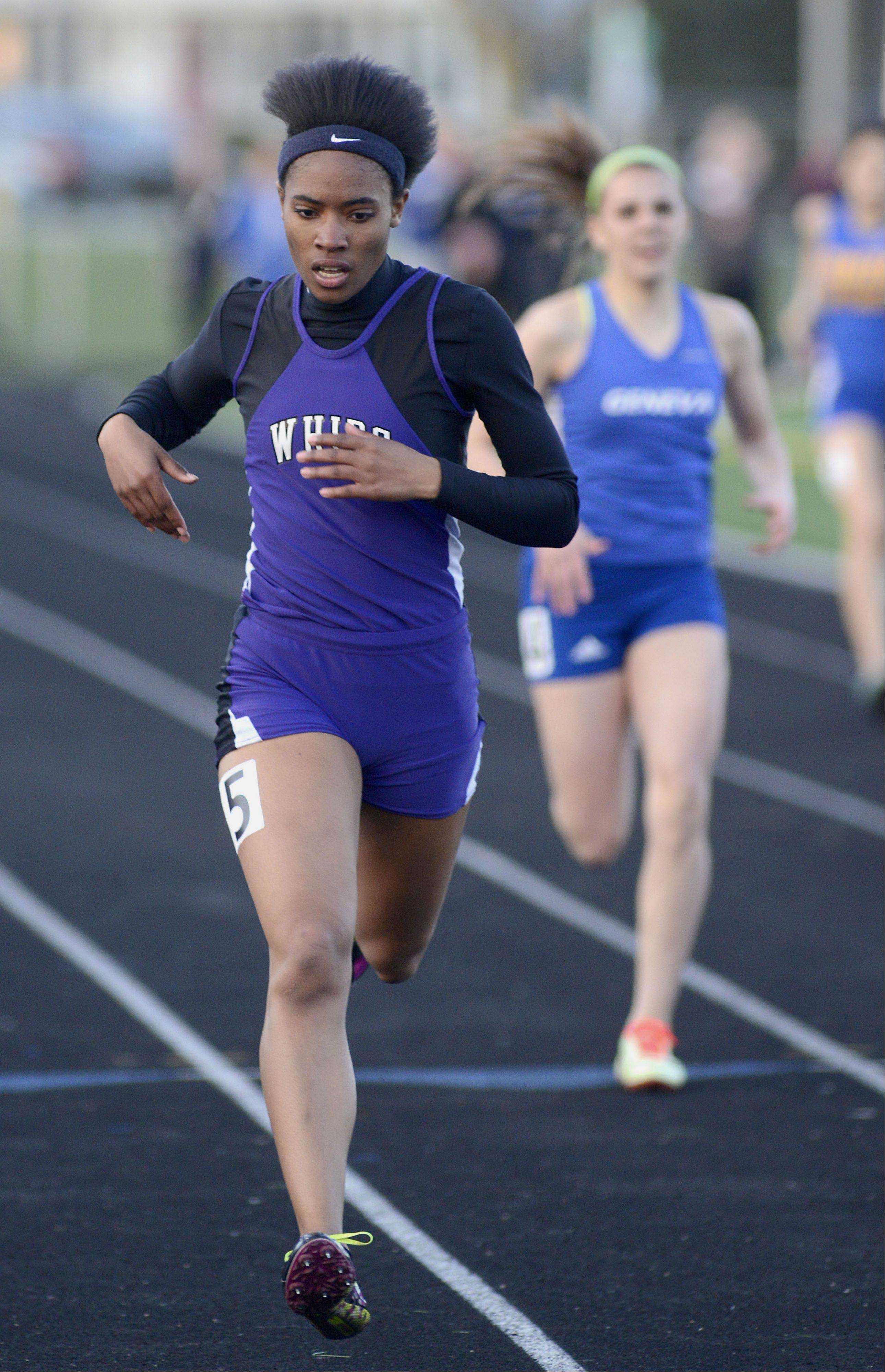 Hampshire's Ashley Fouch wins the final heat of the 400 meter dash finals at the Kane County Invitational track in Geneva meet on Friday, April 26.