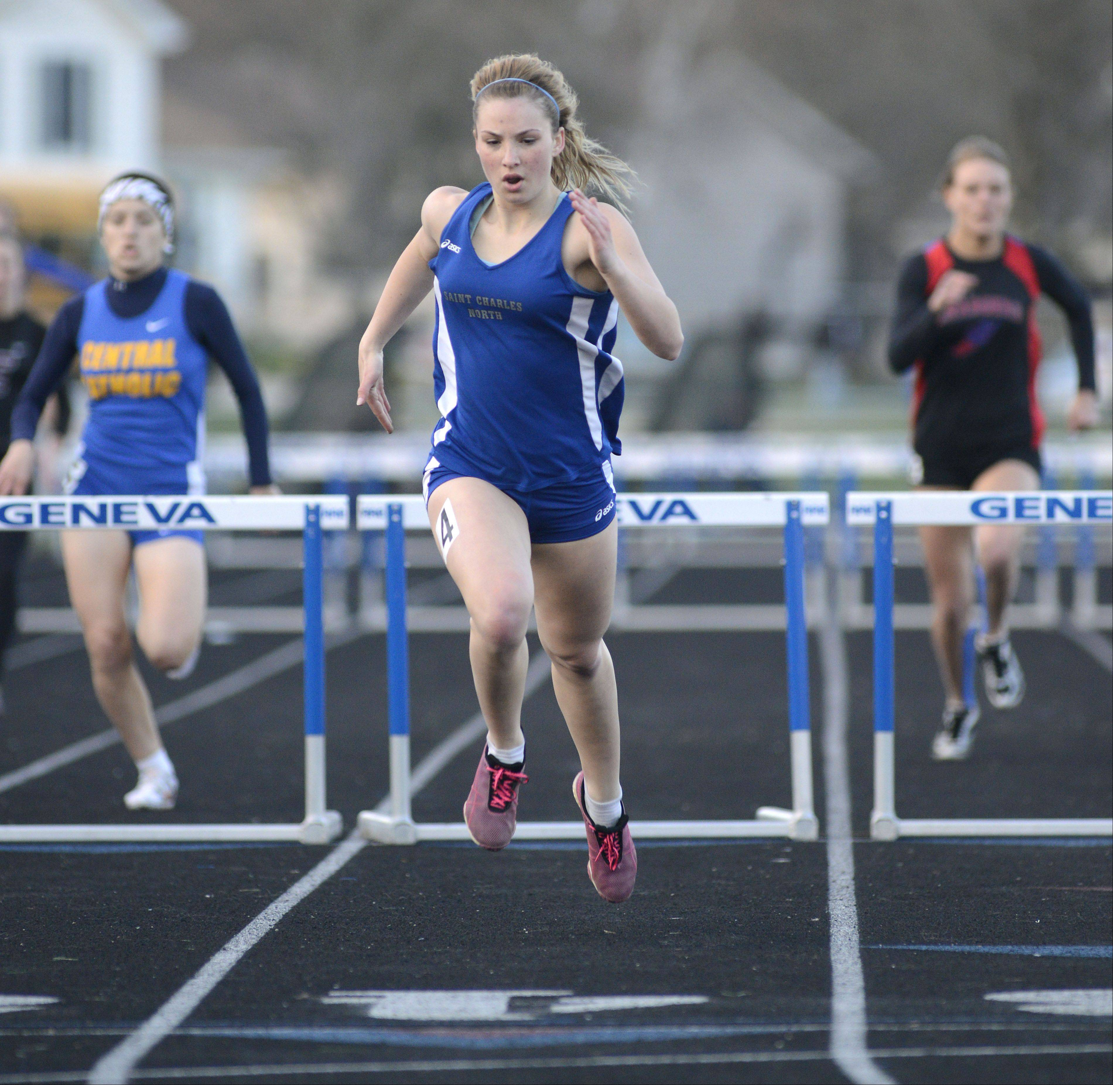 St. Charles North's Alexa Prejna wins the second heat of the 300 meter hurdles at the Kane County Invitational track in Geneva meet on Friday, April 26.