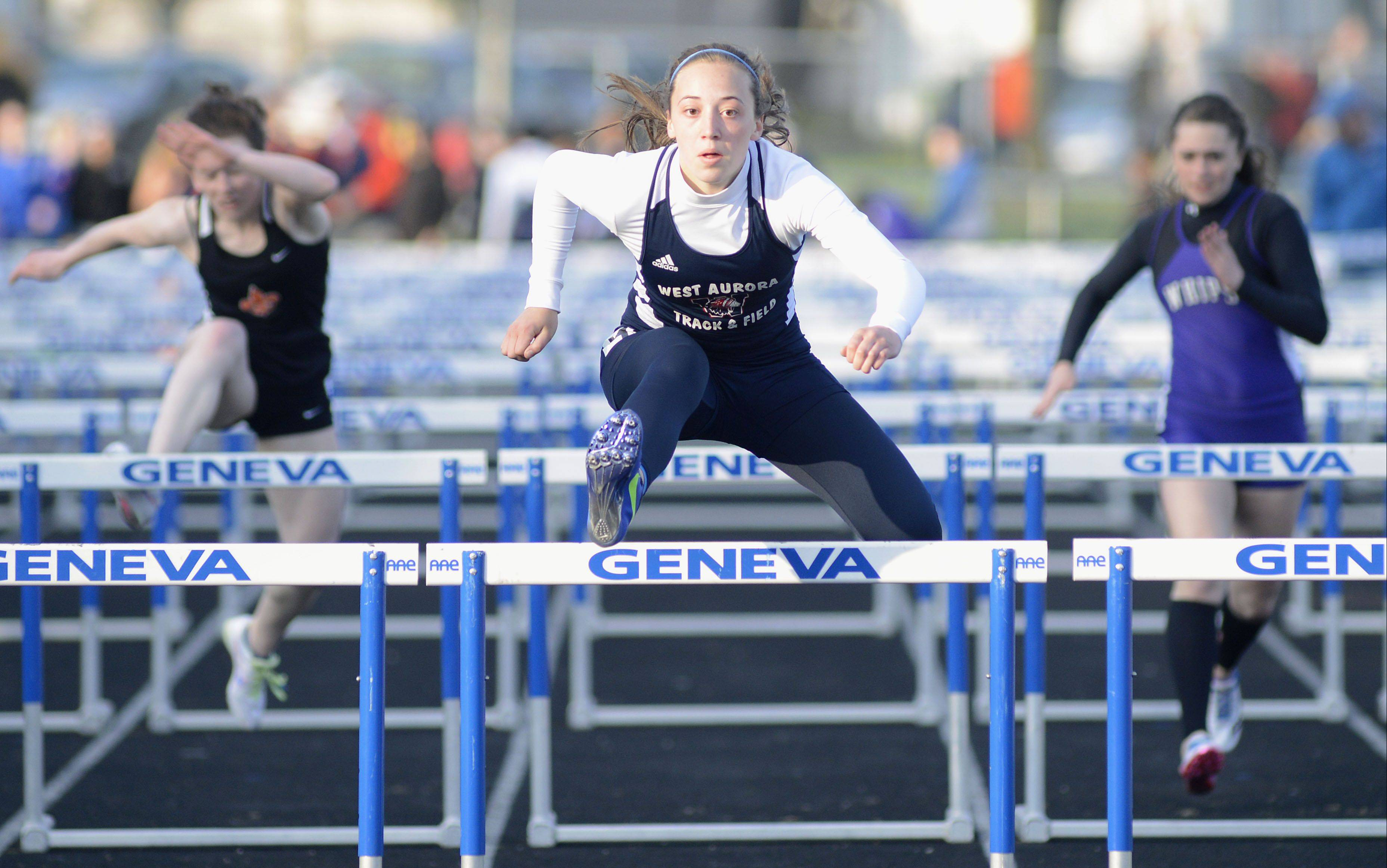 West Aurora's Emma Spagnola won the 100 meter hurdles at the Kane County meet Friday in Geneva.