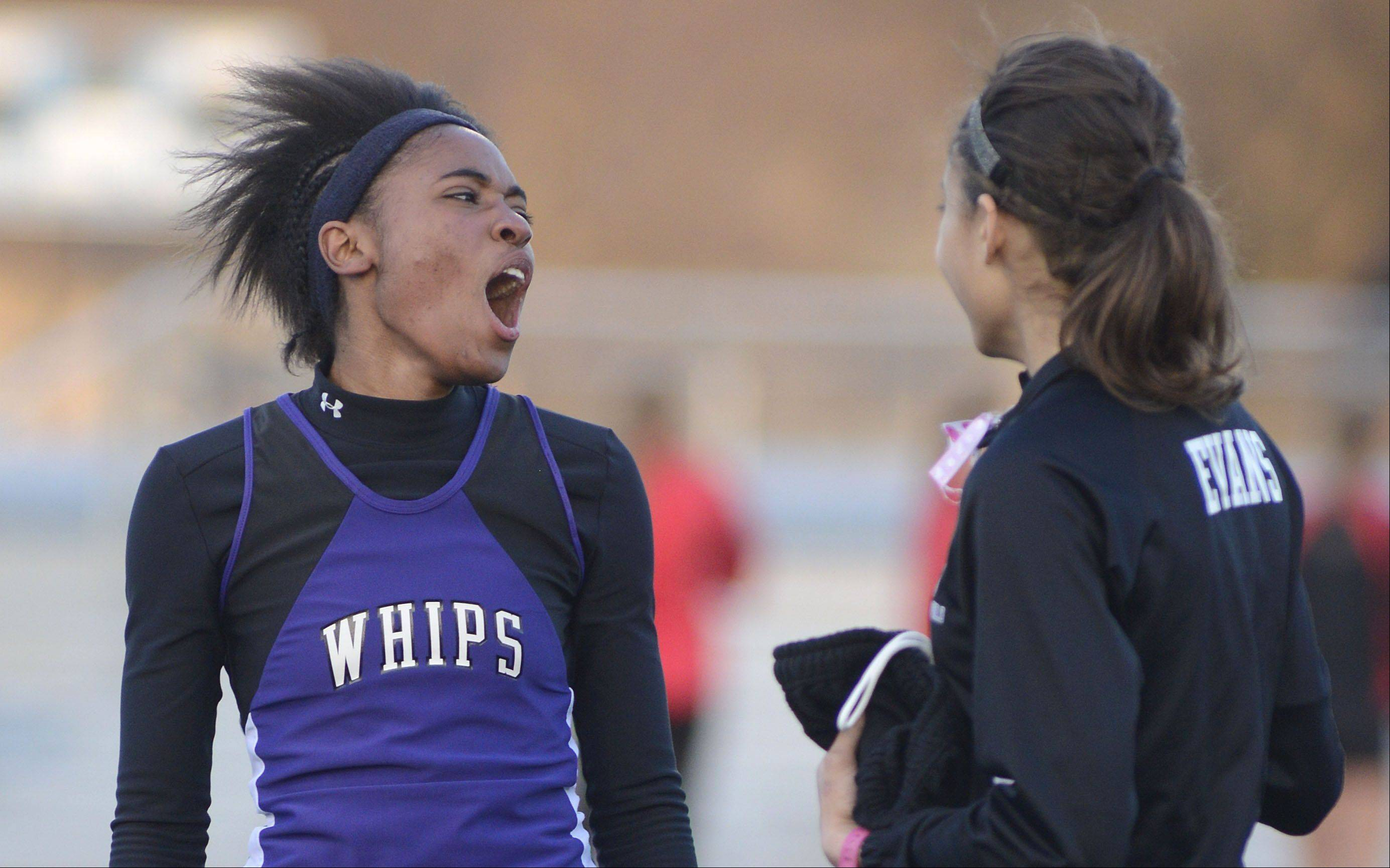 Hampshire's Ashley Fouch celebrates her win in the final heat of the 400 meter dash finals at the Kane County Invitational track in Geneva meet on Friday, April 26.
