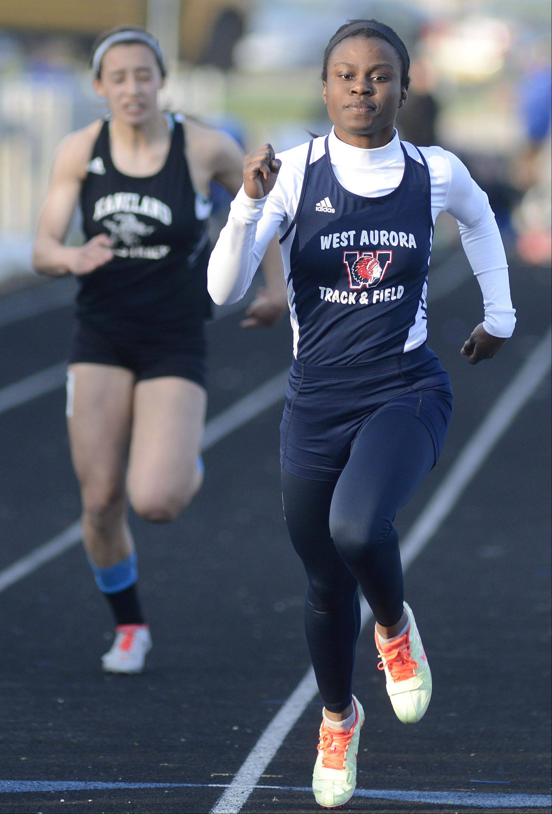 West Aurora's Anita Saffa takes first place in the 100 meter dash final at the Kane County Invitational track in Geneva meet on Friday, April 26.