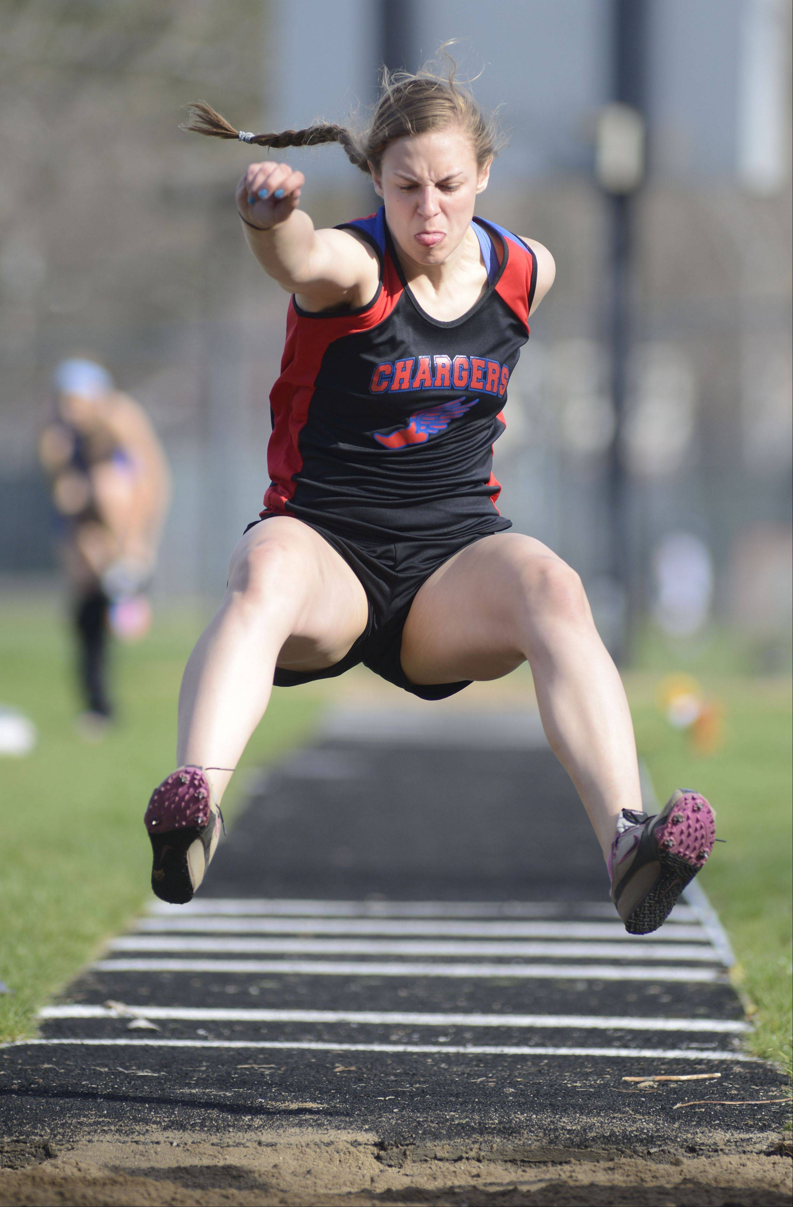 Dundee-Crown's Claire Blume in the long jump at the Kane County Invitational track in Geneva meet on Friday, April 26.