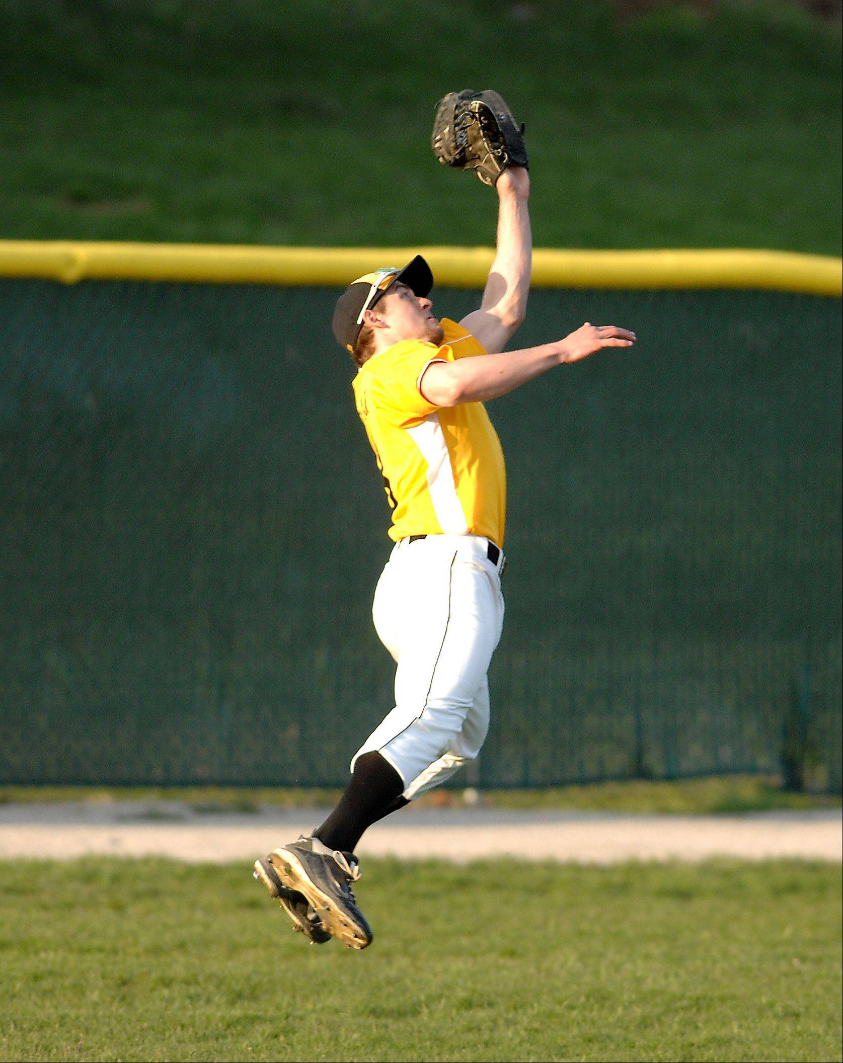 Connor Conzelman of Jacobs makes a leaping catch in left field against Cary-Grove during Friday's game in Cary.