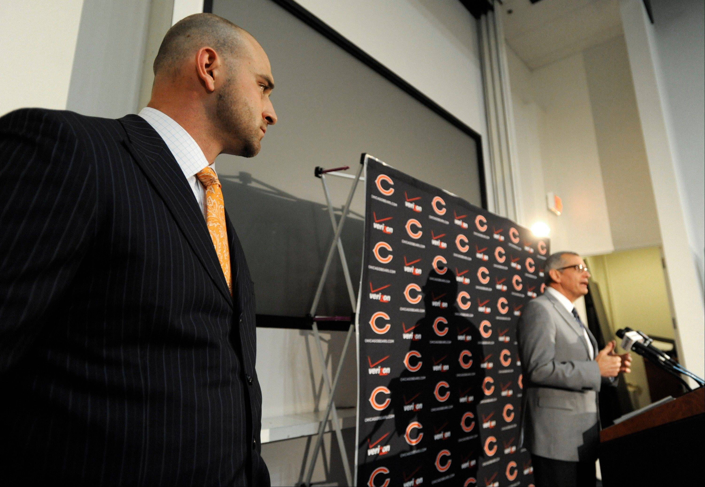 Bears first-round draft pick Kyle Long, left, waits to be introduced to the media by general manager Phil Emery during an NFL football news conference, Friday, April 26, 2013, at Halas Hall in Lake Forest, Ill.�Long, an offensive guard from Oregon, was selected 20th overall in Thursday's NFL draft.