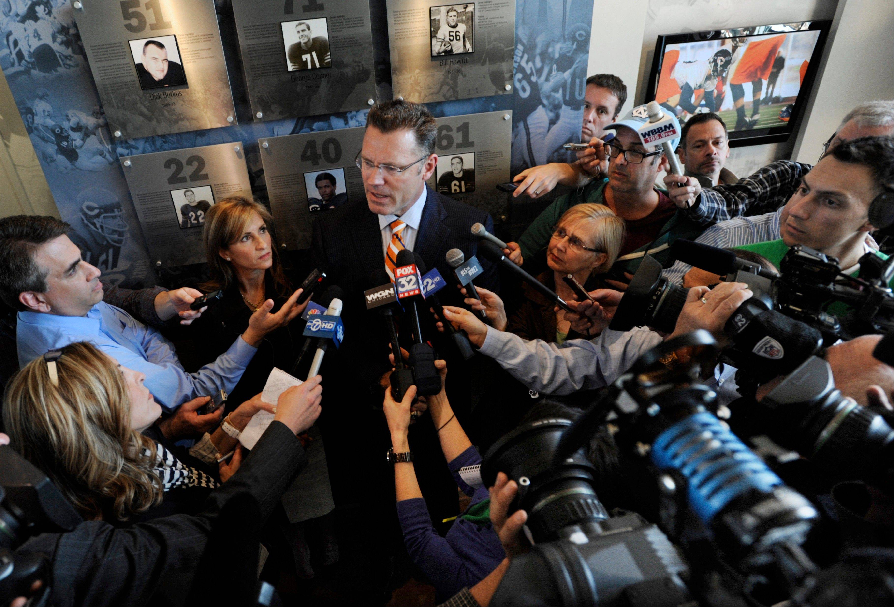 Howie Long, center, former NFL player, actor, studio analyst and father of Oregon guard Kyle Long who is the Chicago Bears first-round pick in the NFL football draft, talks to members of the media after Kyle was introduced on Friday, April 26, 2013, at Halas Hall in Lake Forest, Ill.�Howie's wife Diane left, looks on.