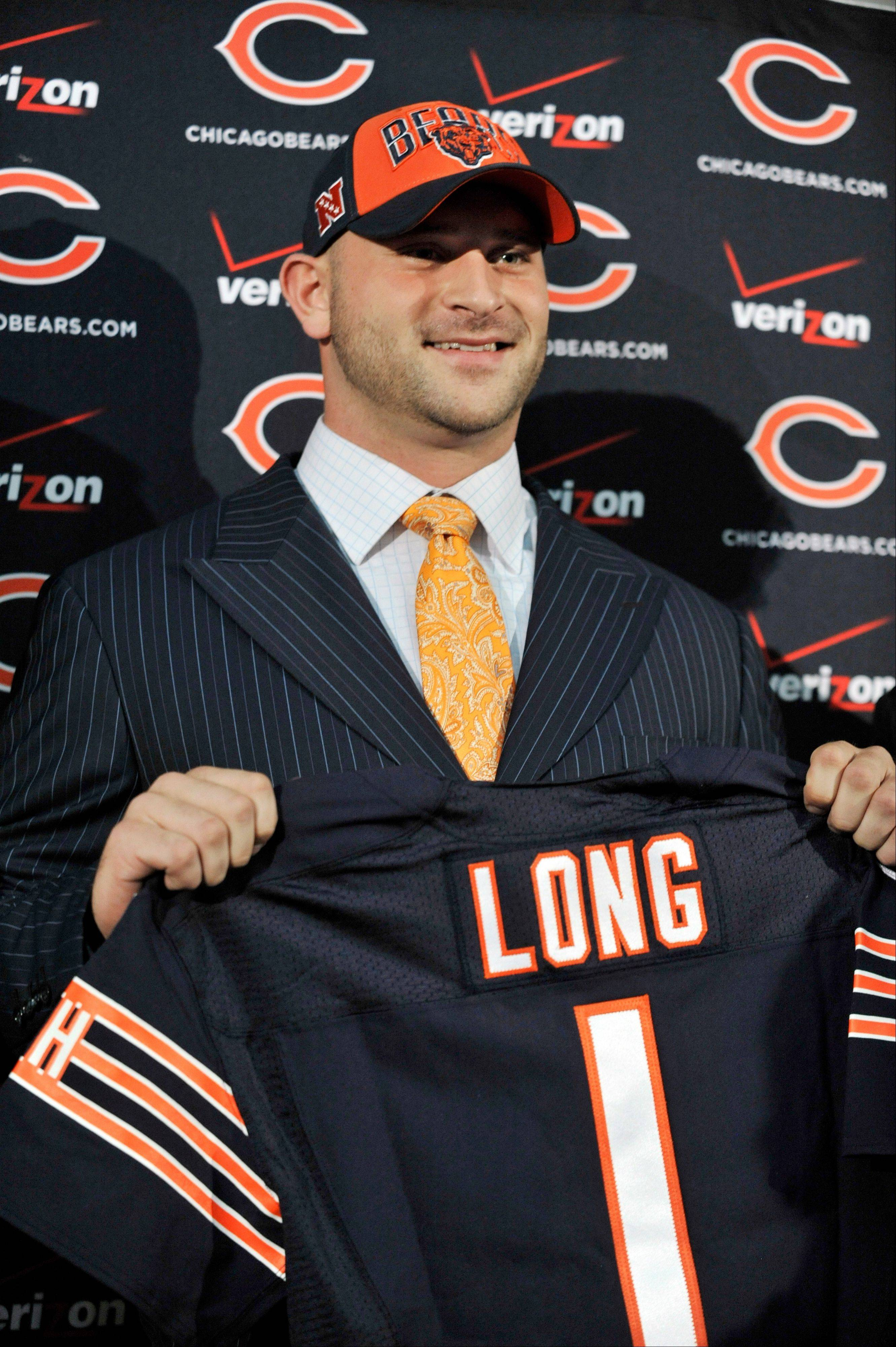 Chicago Bears first round draft Kyle Long holds up a jersey as he is introduced to the media during an NFL football news conference, Friday, April 26, 2013, at Halas Hall in Lake Forest, Ill.�Long, an offensive guard from Oregon, was selected 20th overall in Thursday's NFL draft.