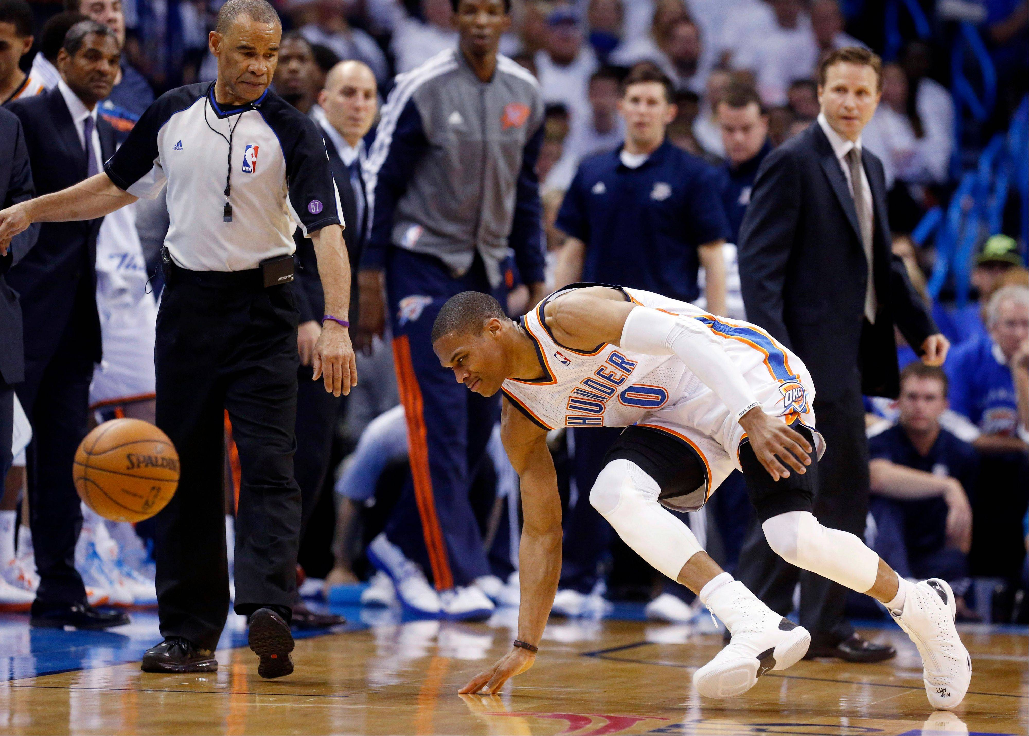 In this photo taken Wednesday, April 24, 2013, Oklahoma City Thunder guard Russell Westbrook stumbles after injuring his right knee in the second quarter of Game 2 of a first-round NBA basketball playoff series against the Houston Rockets in Oklahoma City. Westbrook, who remained in the game, will have surgery to repair a torn meniscus in his right knee and be out indefinitely, dealing a harsh blow to the City Thunder�s championship chances.