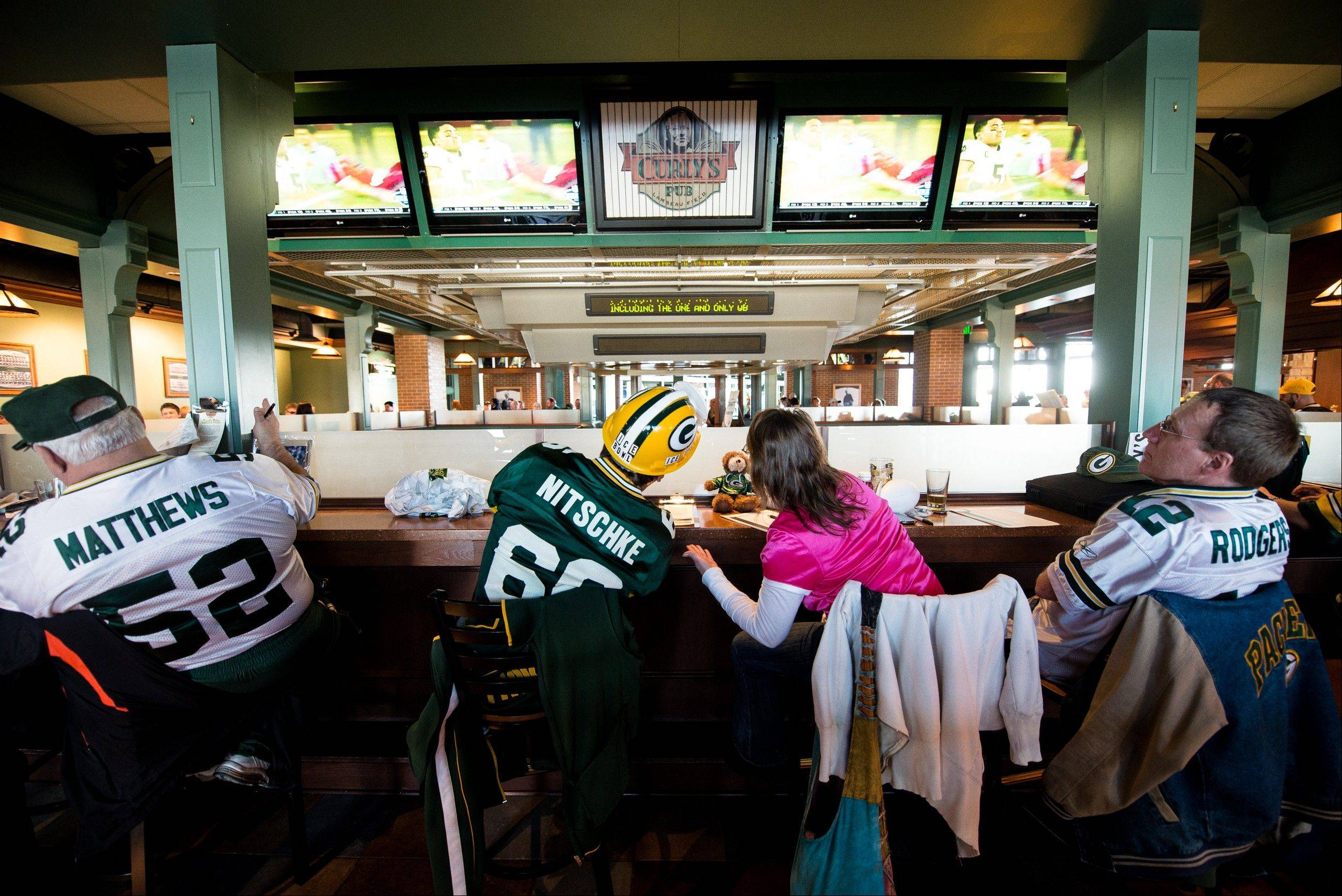 Fans gather at Curly's Pub to watch a televised broadcast of the NFL football draft at Lambeau Field in Green Bay, Wis., Thursday, April 25, 2013.