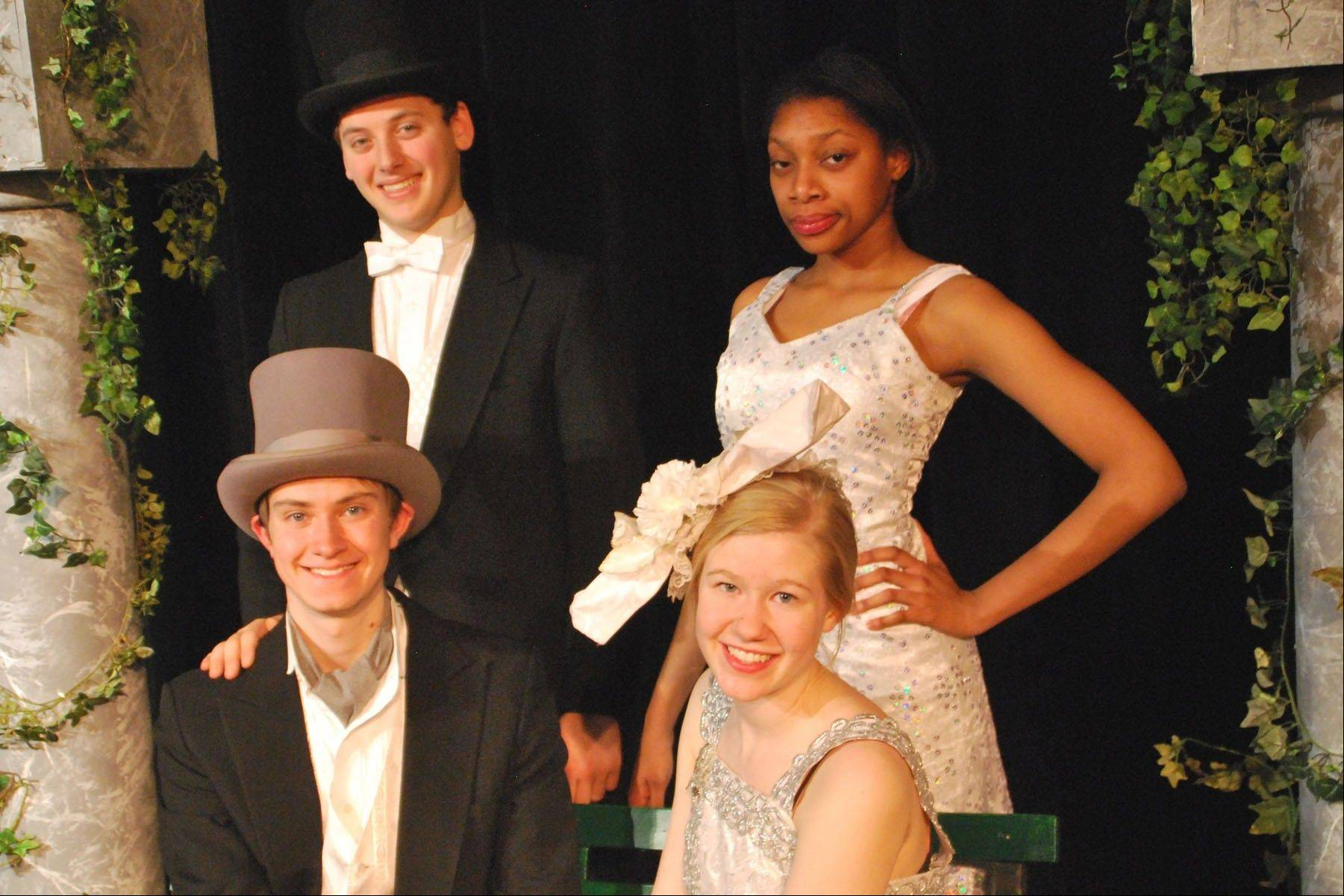 "Cast members of the Mundelein High School production of ""The Drowsy Chaperone,"" front: Stephen Ferro as Robert Martin and Kelsey Hoffmeyer as Janet Van Der Graaff; back: Haggai Simon as George and Chamaya Moody as The Drowsy Chaperone."