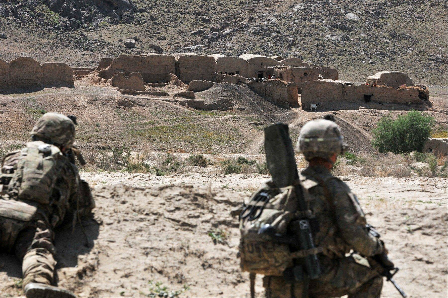 Associated Press.April 10 Soldiers with Charlie Company, 1st Battalion, 38th Infantry Regiment, 4th Brigade Combat Team, 2nd Infantry Division provide security while their comrades search a village in the Panjwai district of Kandahar province, Afghanistan.
