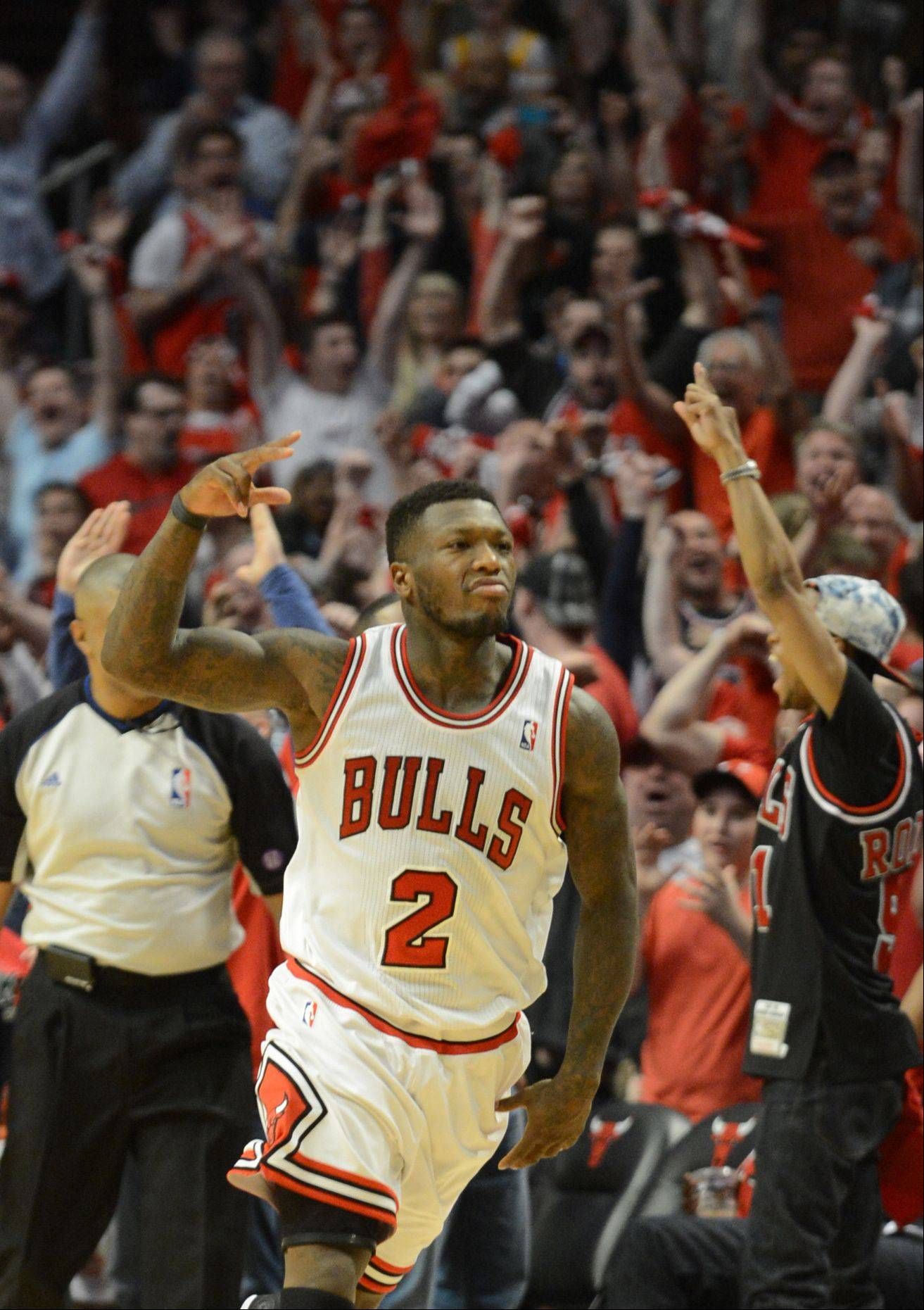 Nate Robinson fires up the crowd in the second overtime Saturday at the United Center. It was Robinson�s big fourth quarter that got the Bulls to overtime.