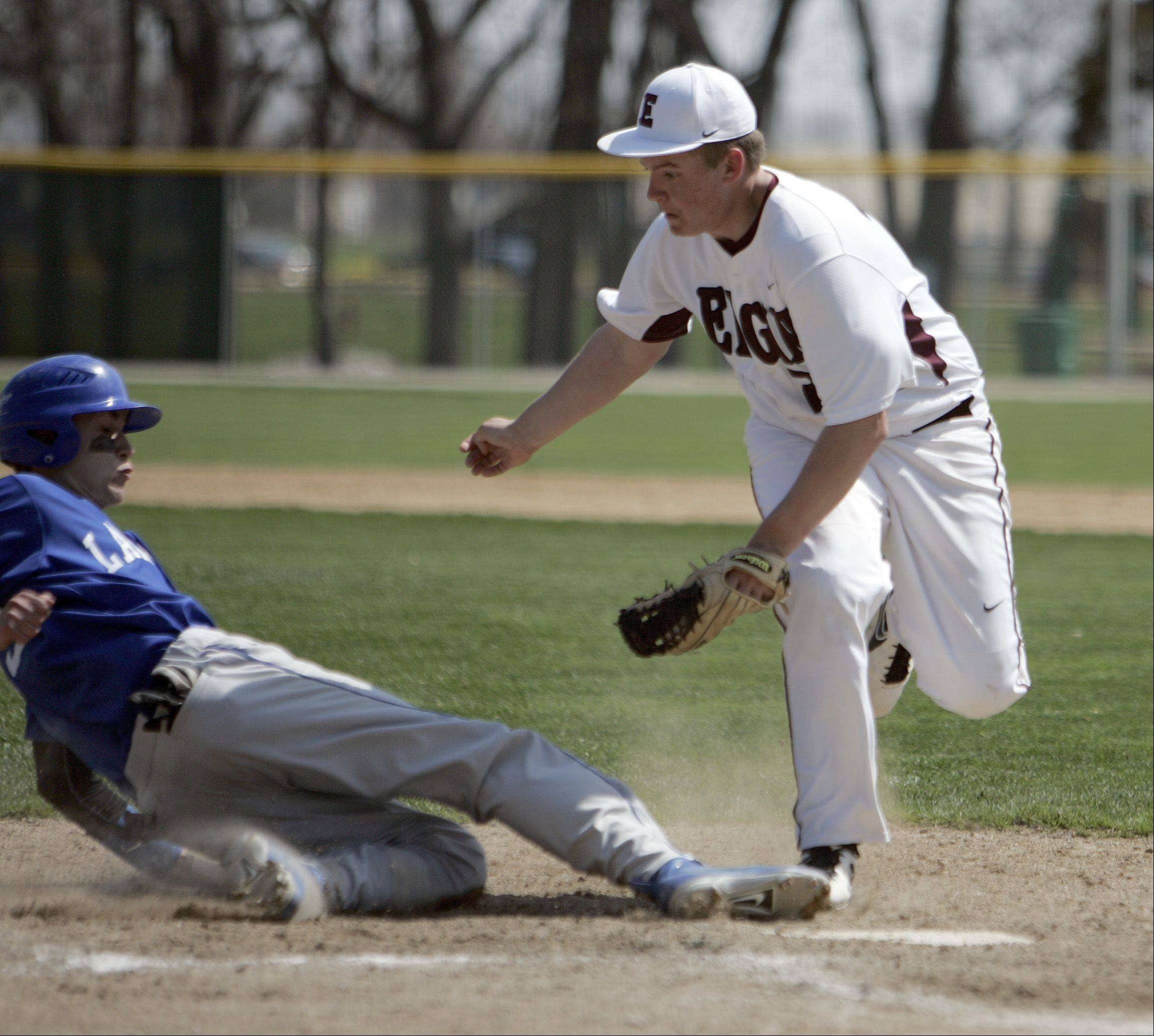 Elgin�s Nicholas Turner tries to put the tag on Larkin�s John Jowaski Saturday at Trout Park.