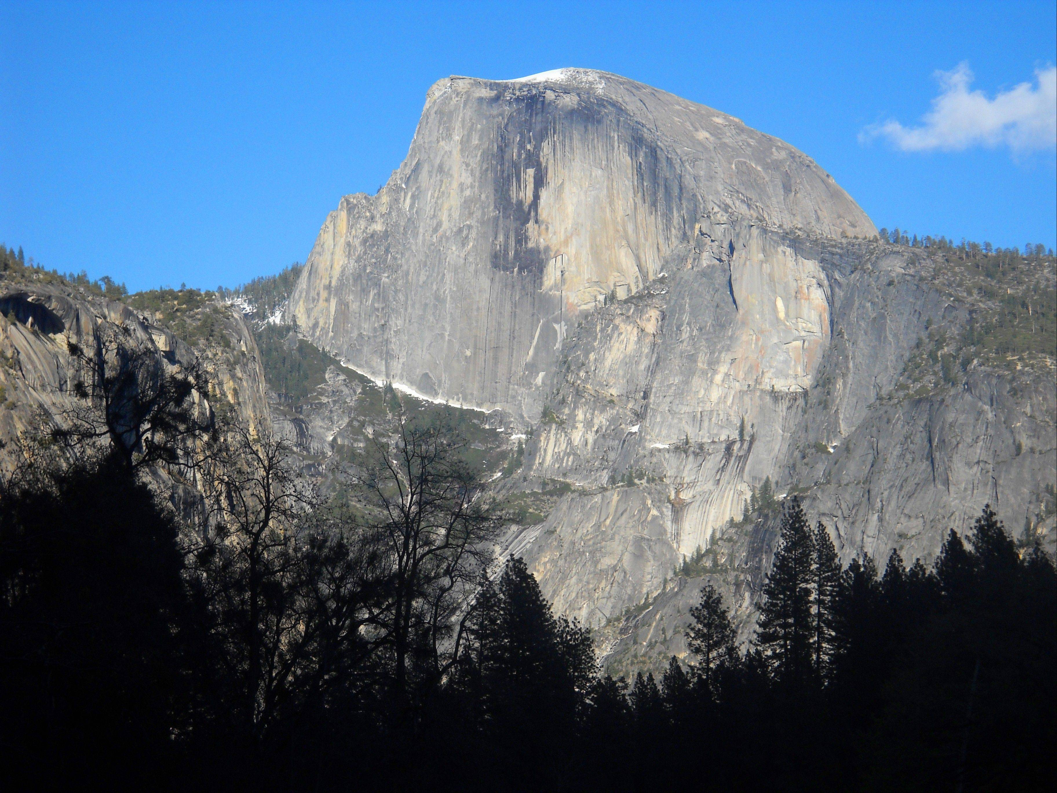 Half Dome is the iconic granite peak in Yosemite National Park.