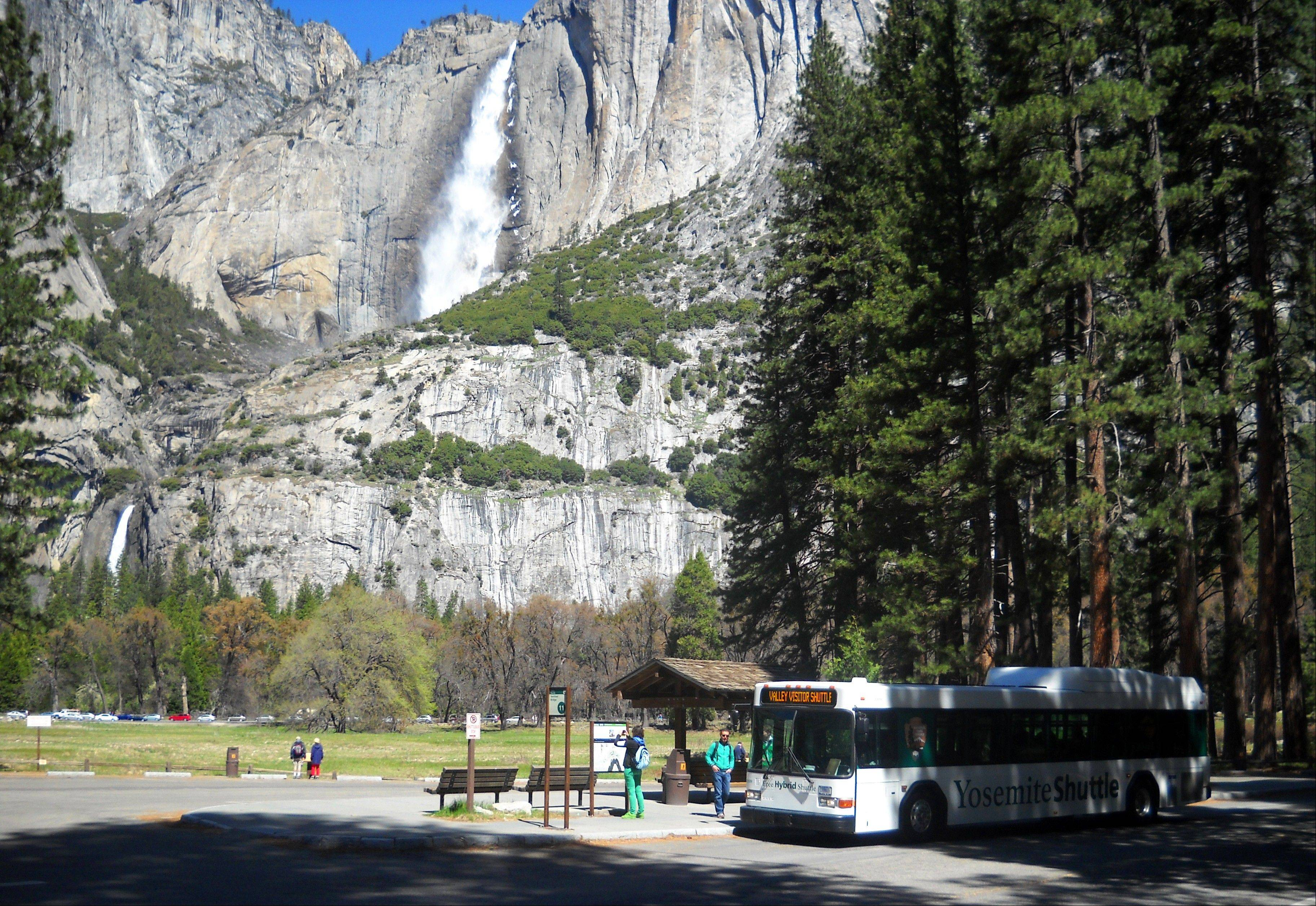The free shuttle bus at Yosemite National Park picks up passengers at Sentinel Bridge.