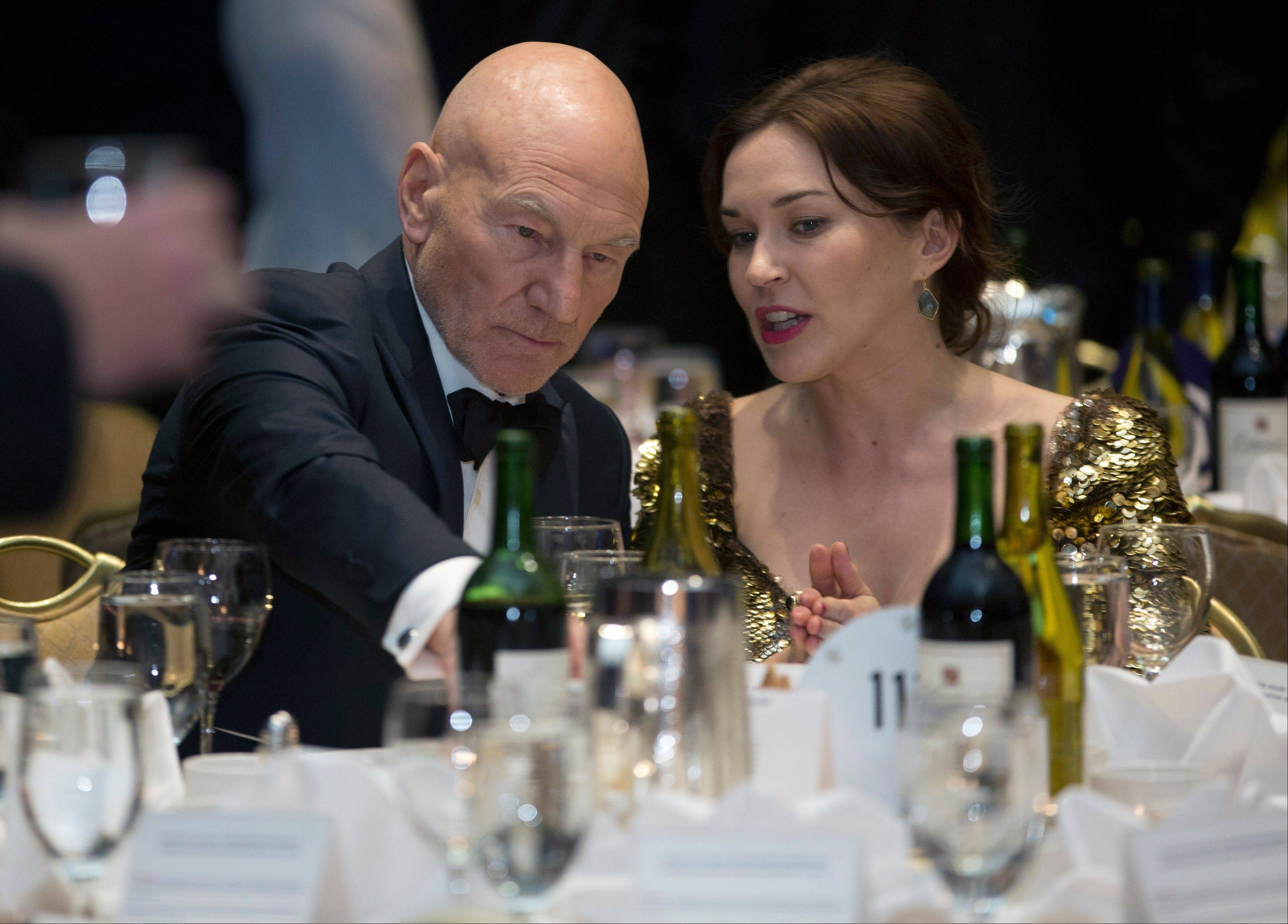 Actor Patrick Stewart, left, and Sunny Ozell attend the White House Correspondents' Association Dinner Saturday at the Washington Hilton Hotel in Washington.