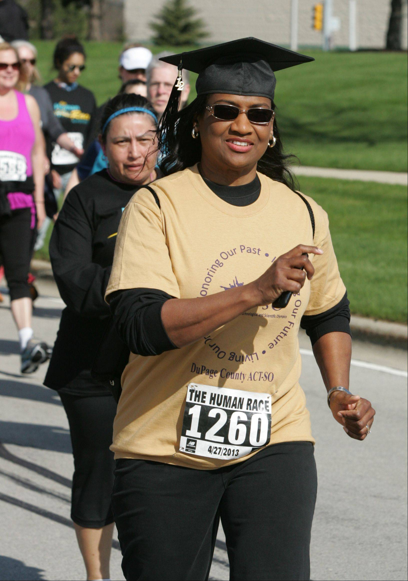 Cynthia Johnson of Lisle is the first walker to cross the finish line Saturday during the second annual Human Race in Downers Grove hosted by Giving DuPage. Johnson participated as co-chairwoman of DuPage County ACT-SO, which stands for the Afro-Academic Cultural, Technological and Scientific Olympics.