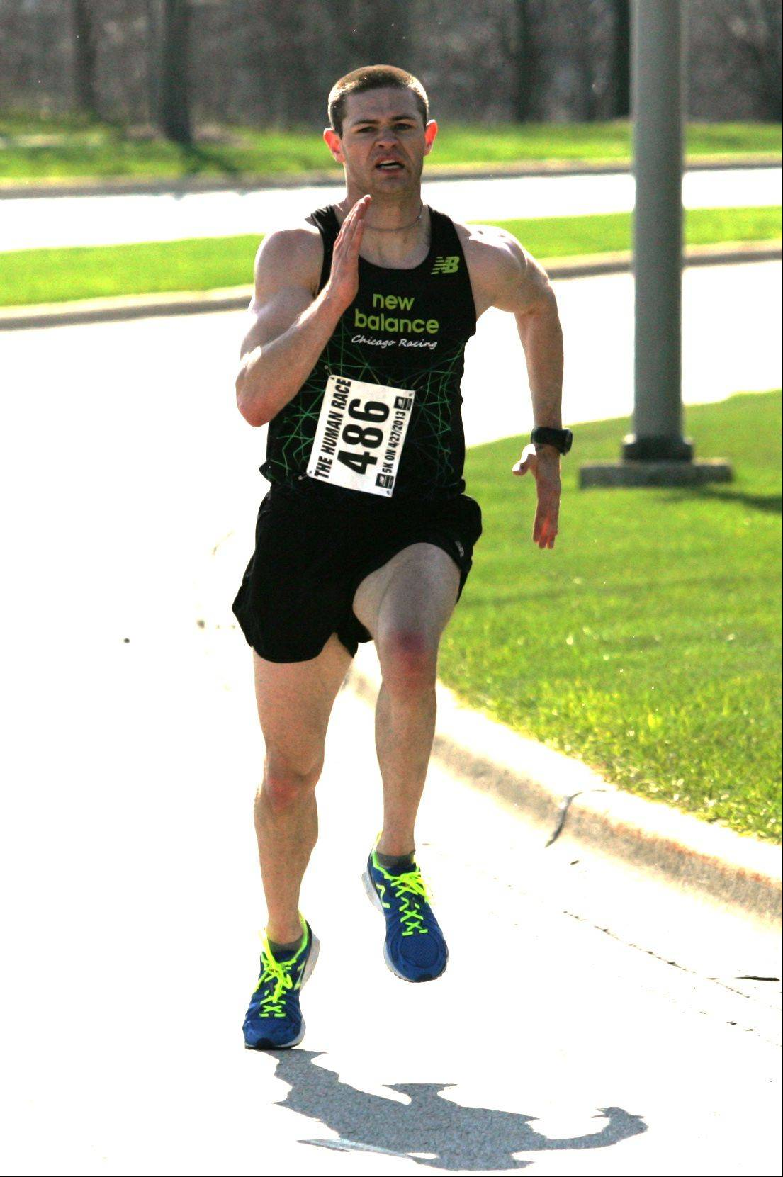 Patrick Austin of Plattville, Ill. wins the second annual Giving DuPage Human Race, a 5K run and 2-mile held Saturday morning in Downers Grove.