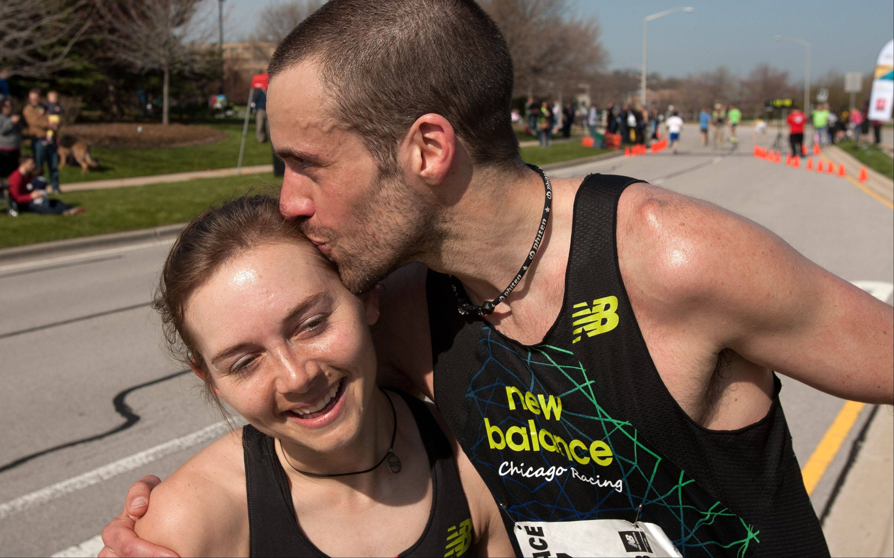 Michael Lucchesi of Lisle congratulates his girlfriend, Kristen Heckert of Lisle, after the Giving DuPage Human Race 5K on Saturday in Downers Grove. Lucchesi finished second, while Heckert finished first among women runners.