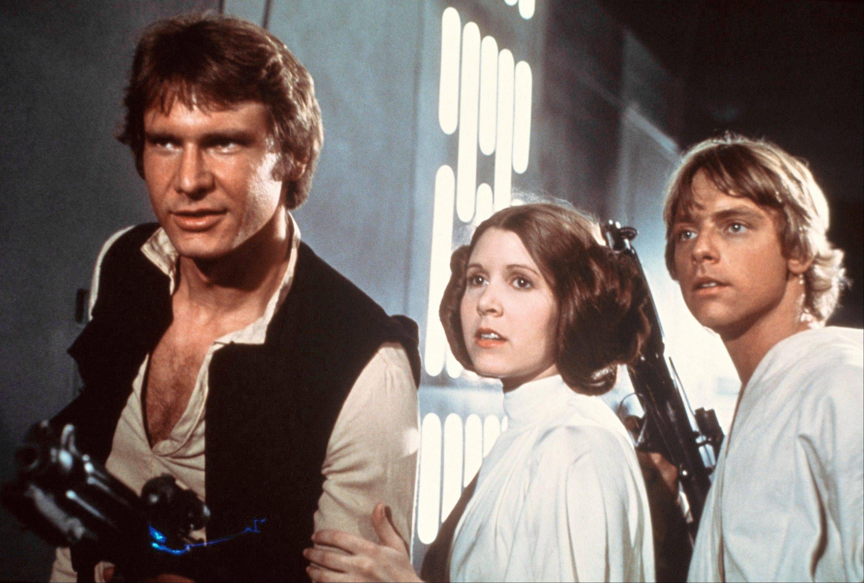 "Associated PressHarrison Ford as Han Solo, Carrie Fisher as Princess Leia Organa and Mark Hamill as Luke Skywalker in a scene from ""Star Wars."""