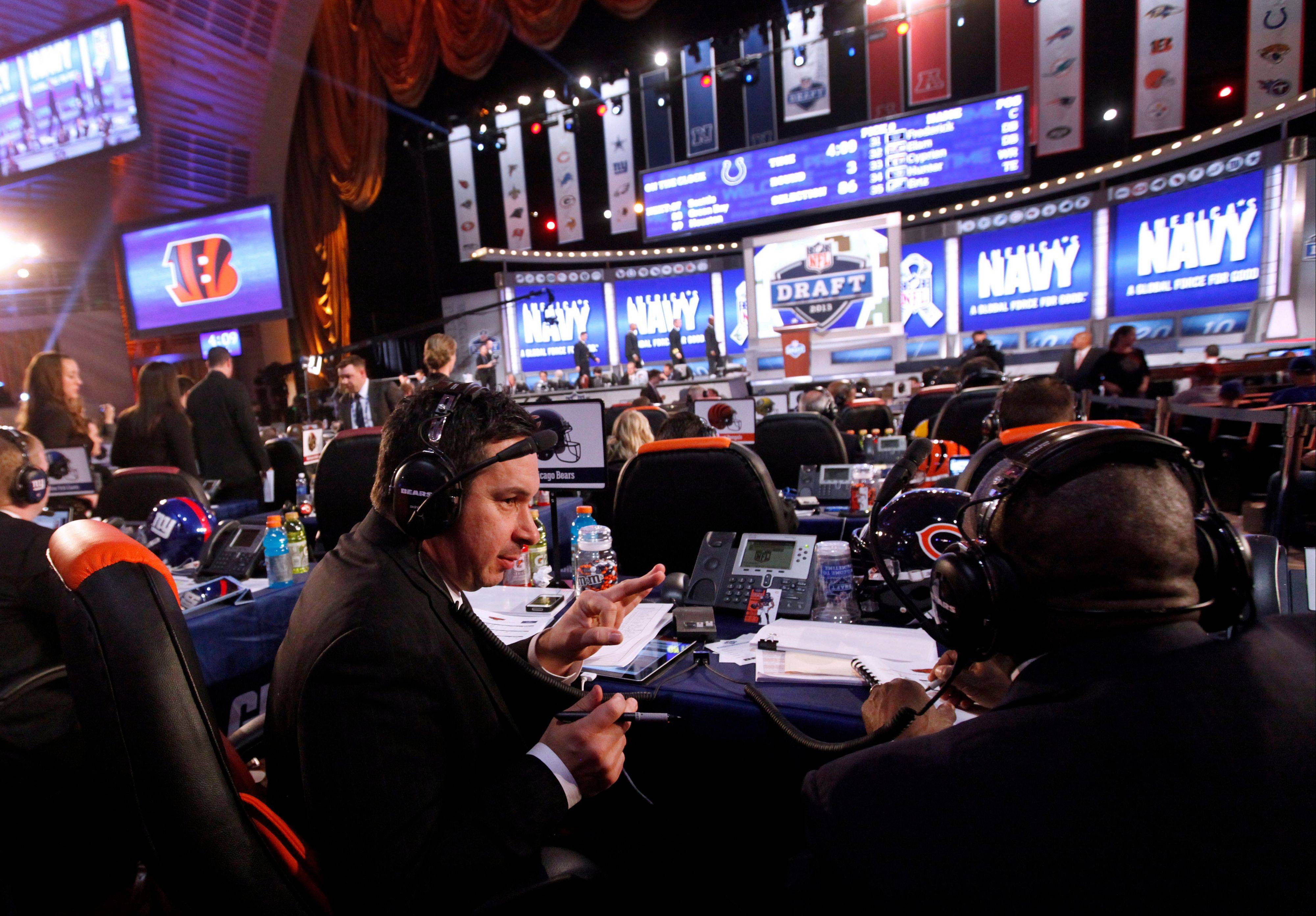 Members of the Chicago Bears organization confer during the third round Friday of the NFL football draft.