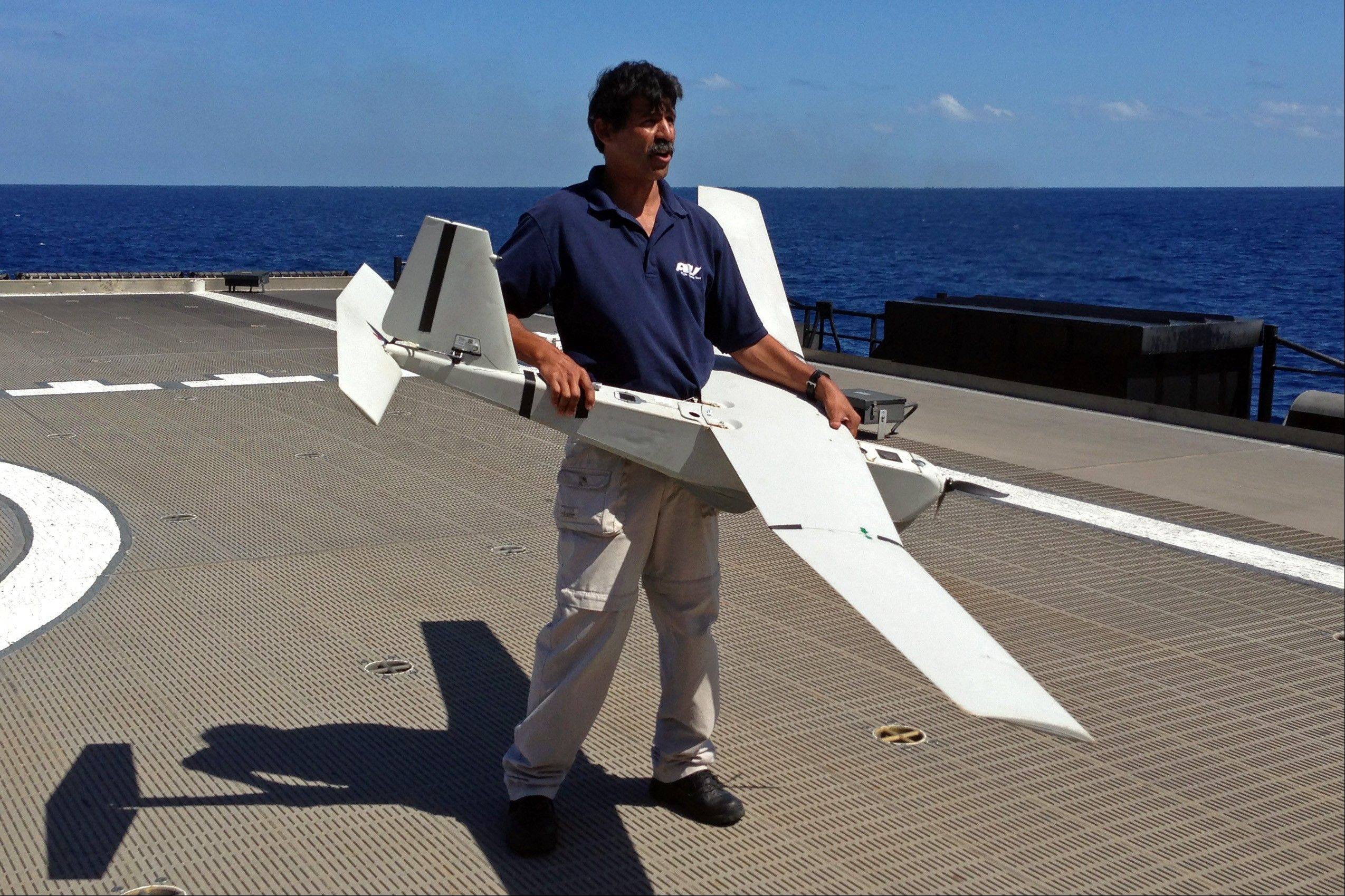 Stuart Orozco, flight operator with Aeronvironment Inc., prepares Friday to launch a UAS (unmanned aircraft system) named Puma from the deck of the U.S. Navy high speed vessel Swift, near Key West, Florida.