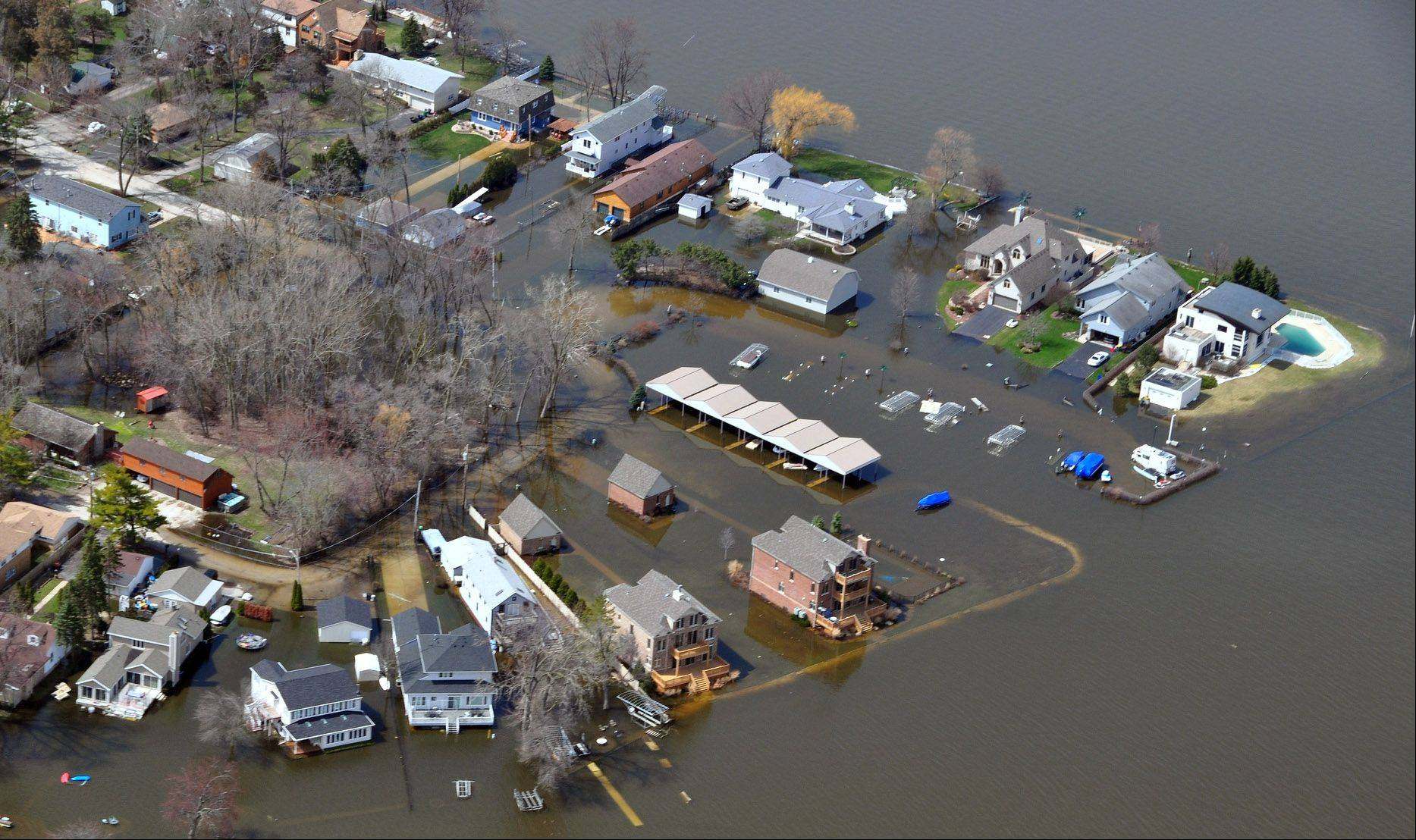 Pistakee Lake flooding in Fox Lake left many homes surrounded and damaged by floodwaters.