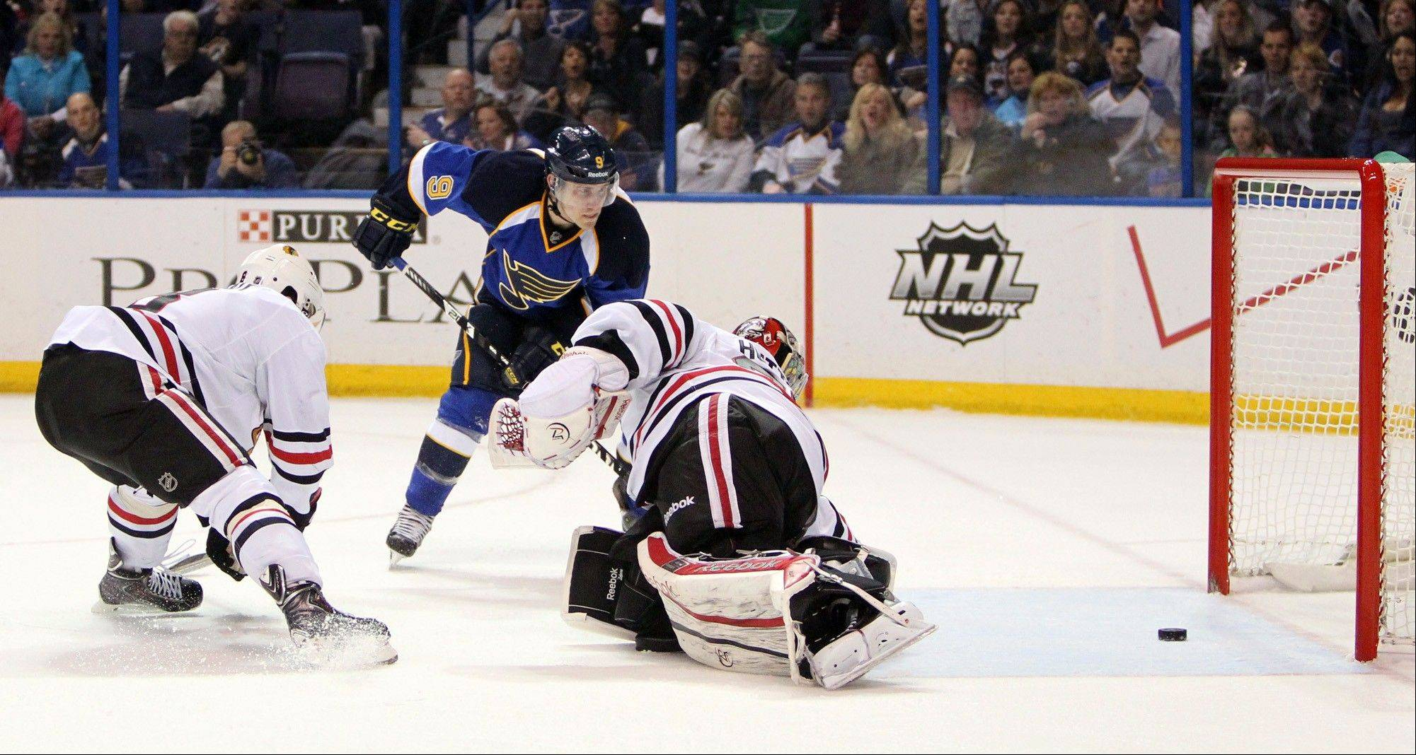 St. Louis Blues forward Jaden Schwartz scores past Chicago Blackhawks goaltender Carter Hutton in the first period of an NHL hockey game on Saturday, April 27, 2013, at the Scottrade Center in St. Louis.