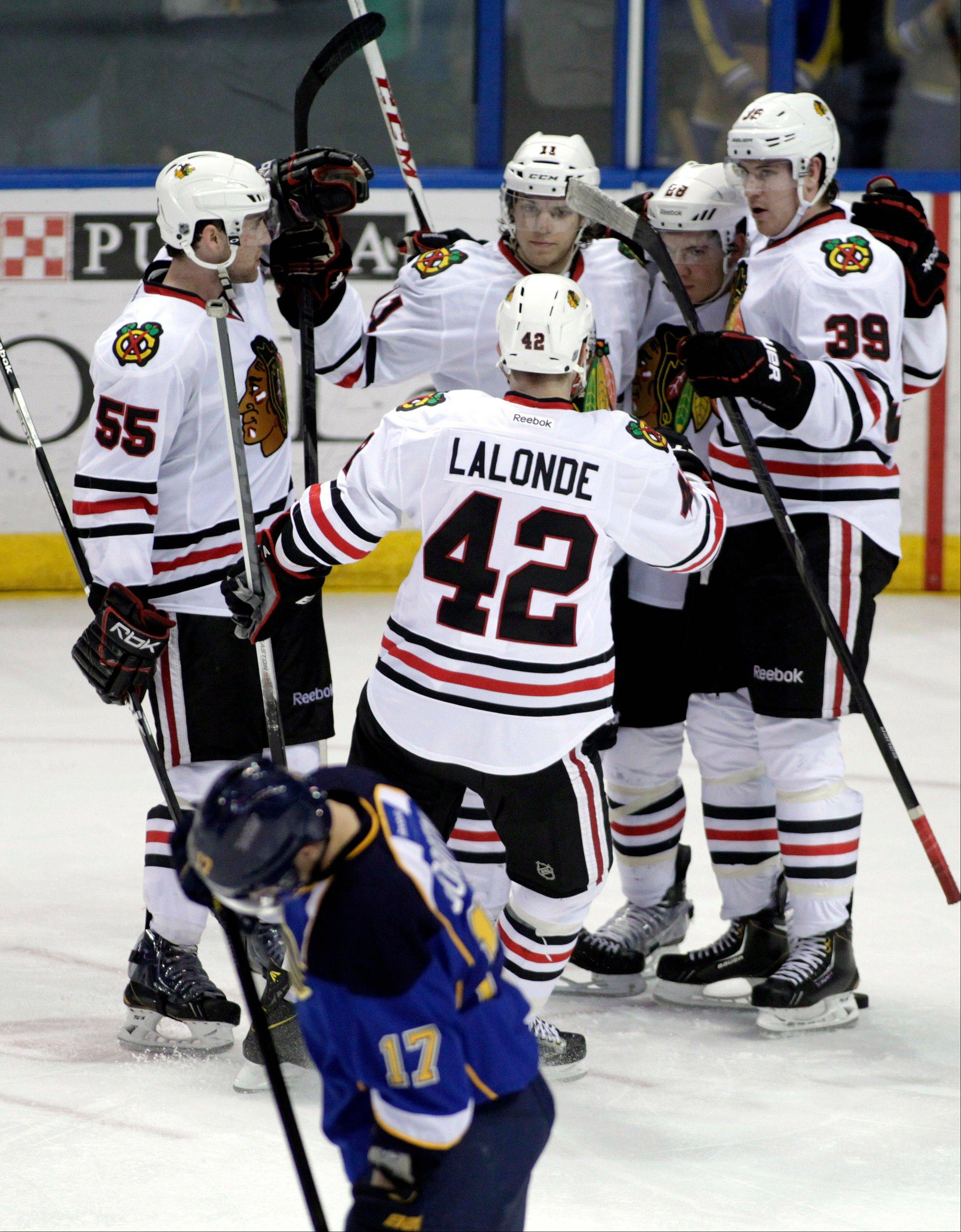 Chicago Blackhawks' Ben Smith (28) is congratulated by teammates Ryan Stanton (55), Shawn Lalaonde (42), Jimmy Hayes (39) and Jeremy Morin (11) after he scored a goal in the third period of an NHL hockey game against the St. Louis Blues, Saturday, April 27, 2013 in St. Louis. The Blues beat the Blackhawks 3-1.