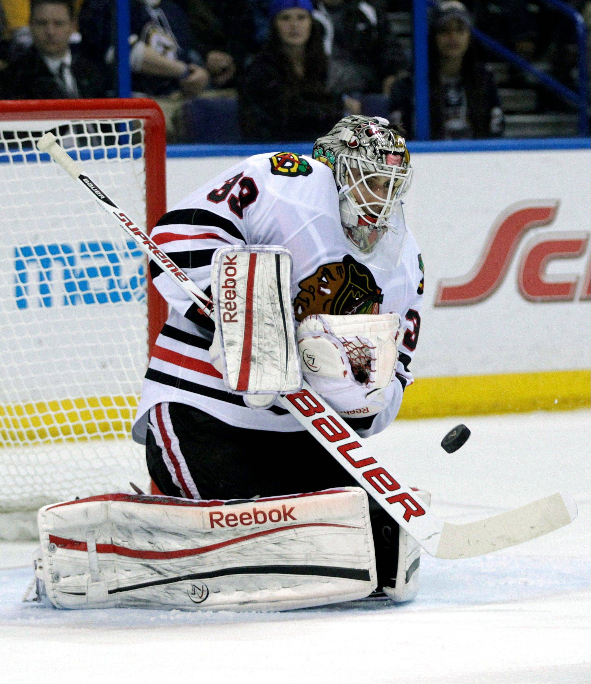 Chicago Blackhawks goalie Carter Hutton (33) makes a save in the second period of an NHL hockey game against the St. Louis Blues, Saturday, April 27, 2013 in St. Louis.