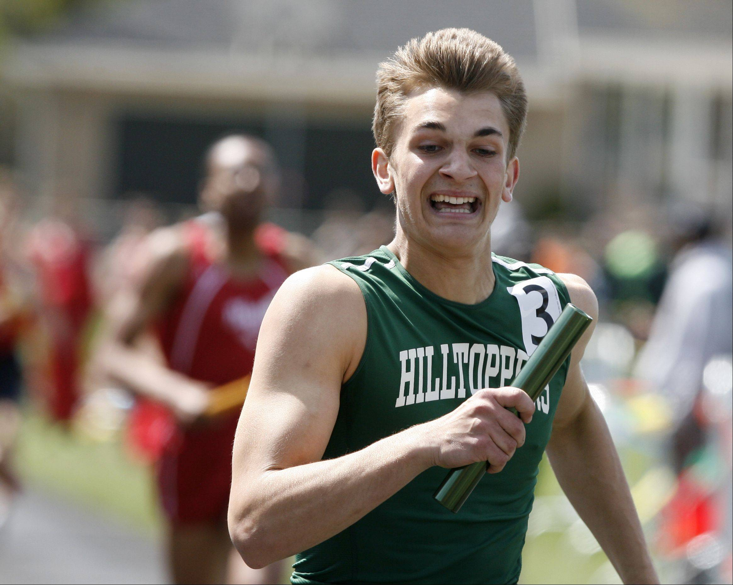 Glenbard West's Connor Schrauth anchors the 4 x 400 meter relay, during the final heat of the Glenbard West boys track invitational.