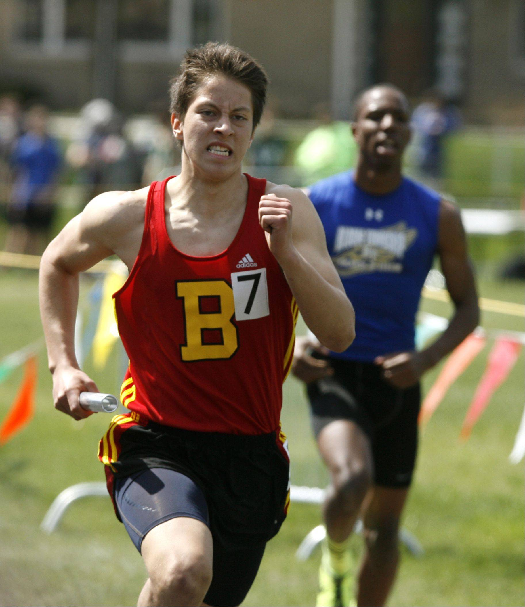 Batavia's Omar Medina anchors the 4 x 400 meter relay, during the final heat of the Glenbard West boys track invitational.