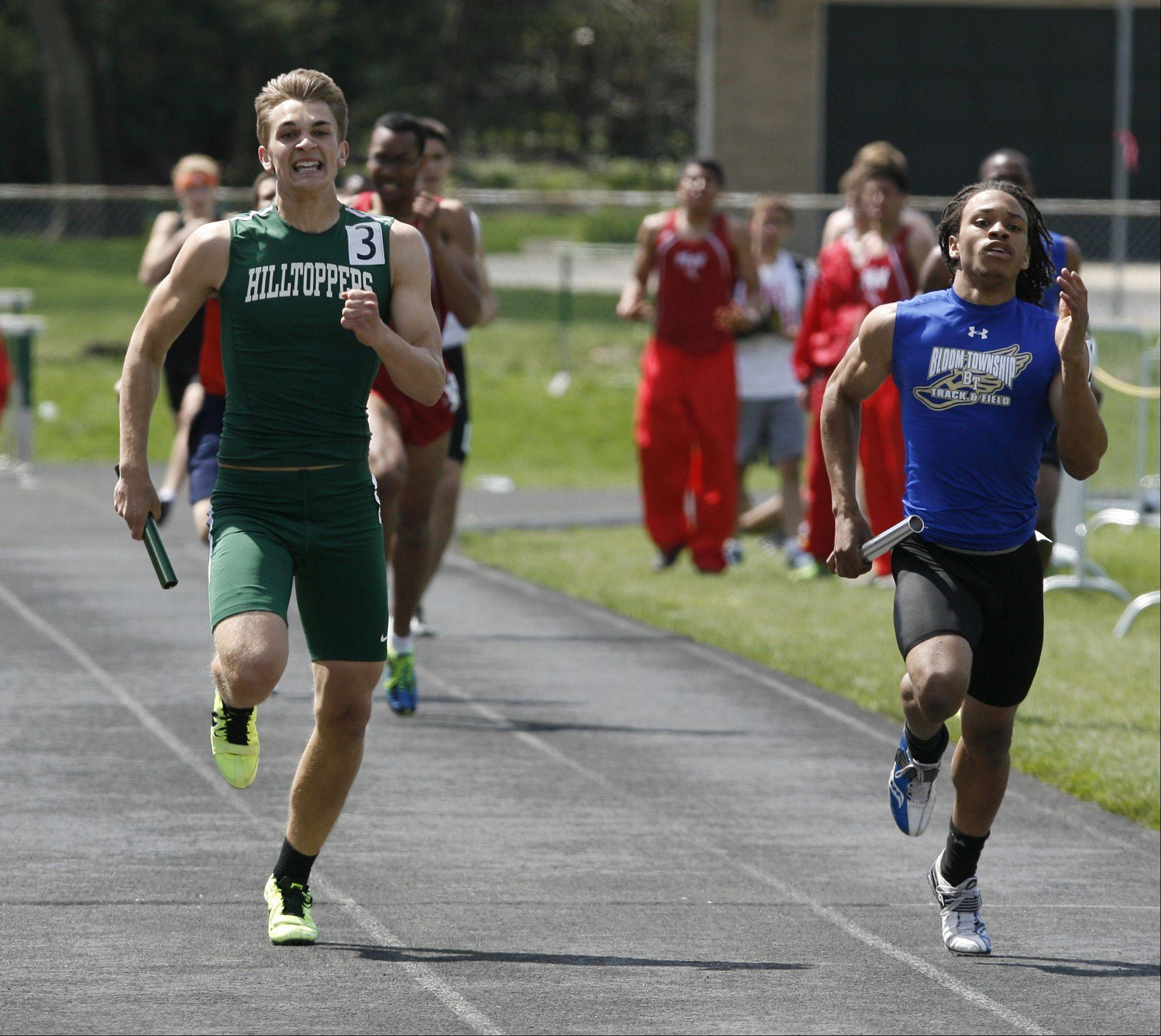 Glenbard West's Connor Schrauth, left, anchors the 4 x 400 meter relay, during the final heat of the Glenbard West boys track invitational.