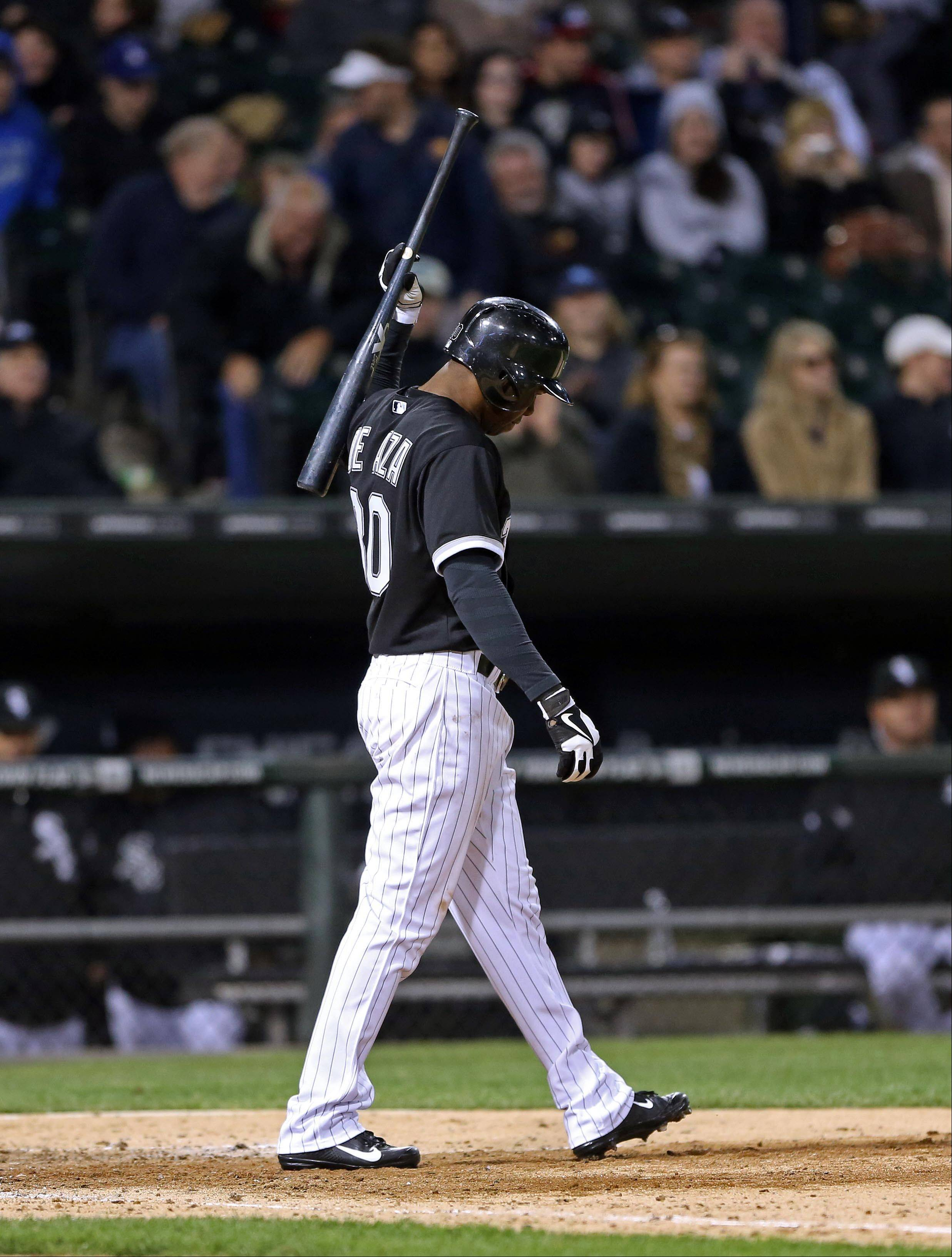 The White Sox's Alejandro De Aza strikes out with the bases loaded to end the eighth inning against the Tampa Bay Rays Saturday night at U.S. Cellular Field. The Sox lost 10-4.