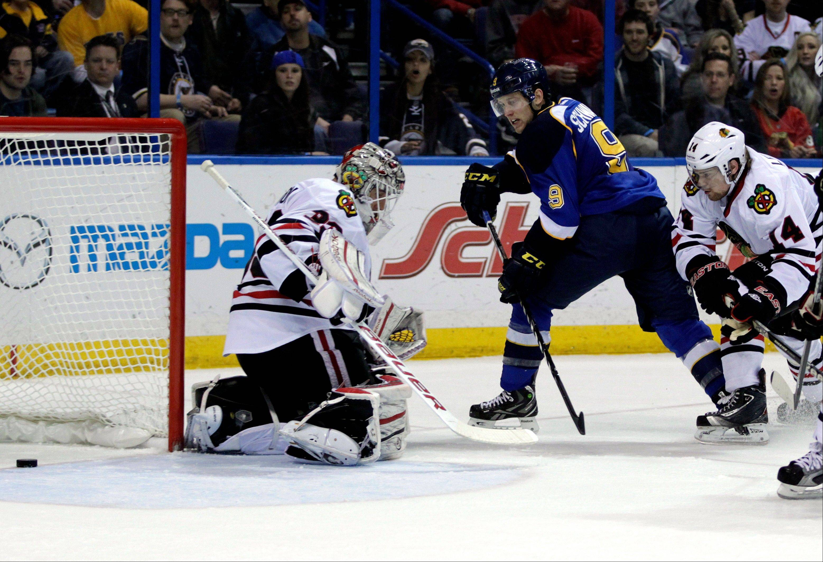 St. Louis Blues' Jaden Schwartz (9) slides the puck past Blackhawks goalie Carter Hutton (33) for his second goal of the game Saturday in St. Louis. The Blackhawks lost 3-1.