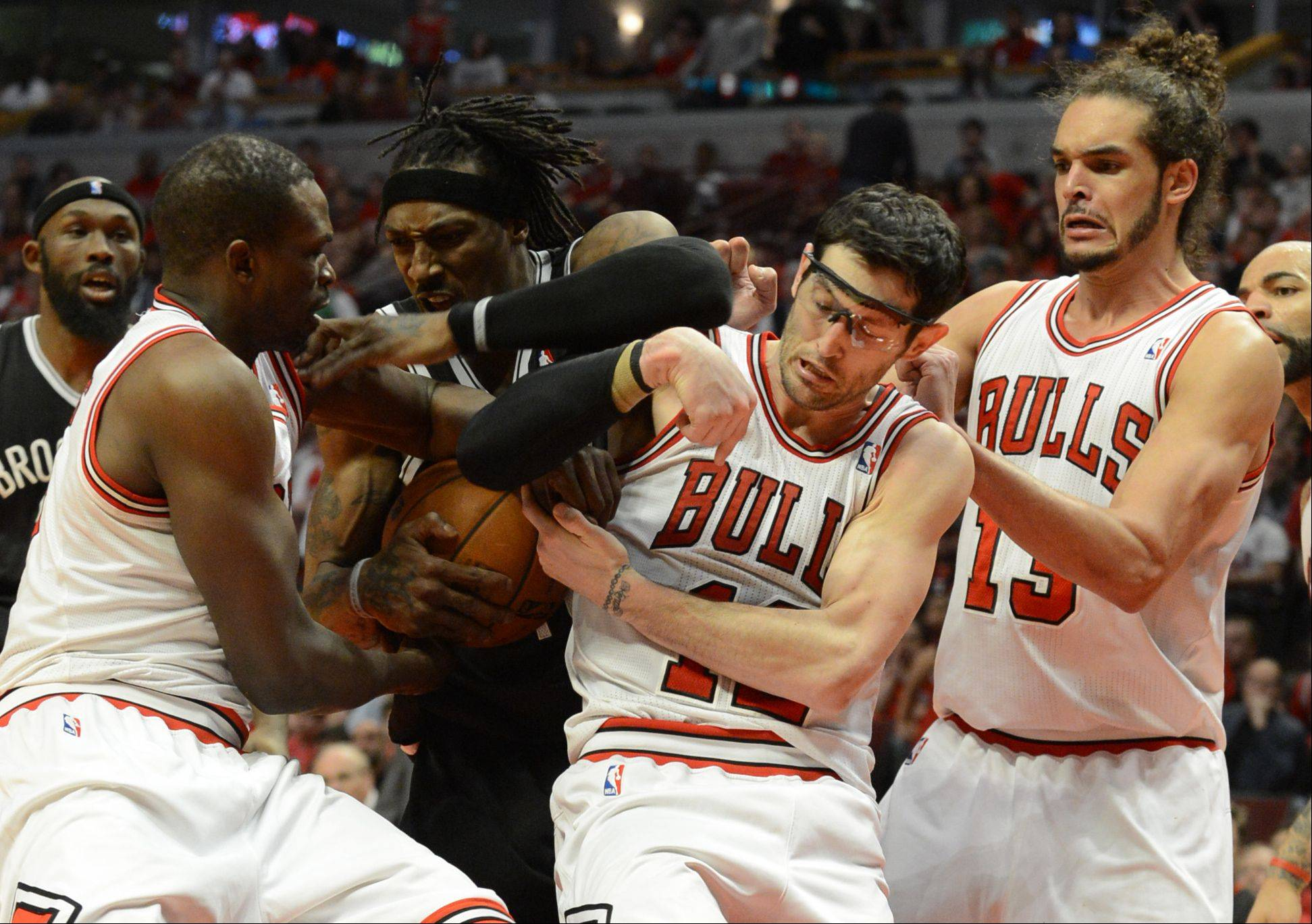 The Bulls Loul Deng, left, Kirk Hinrich and Joakim Noah fight for the ball with Brooklyn's Gerald Wallace Saturday during game 4 of the first round playoff game against the Brooklyn Nets at the United Center. The Bulls won in triple overtime 142-134